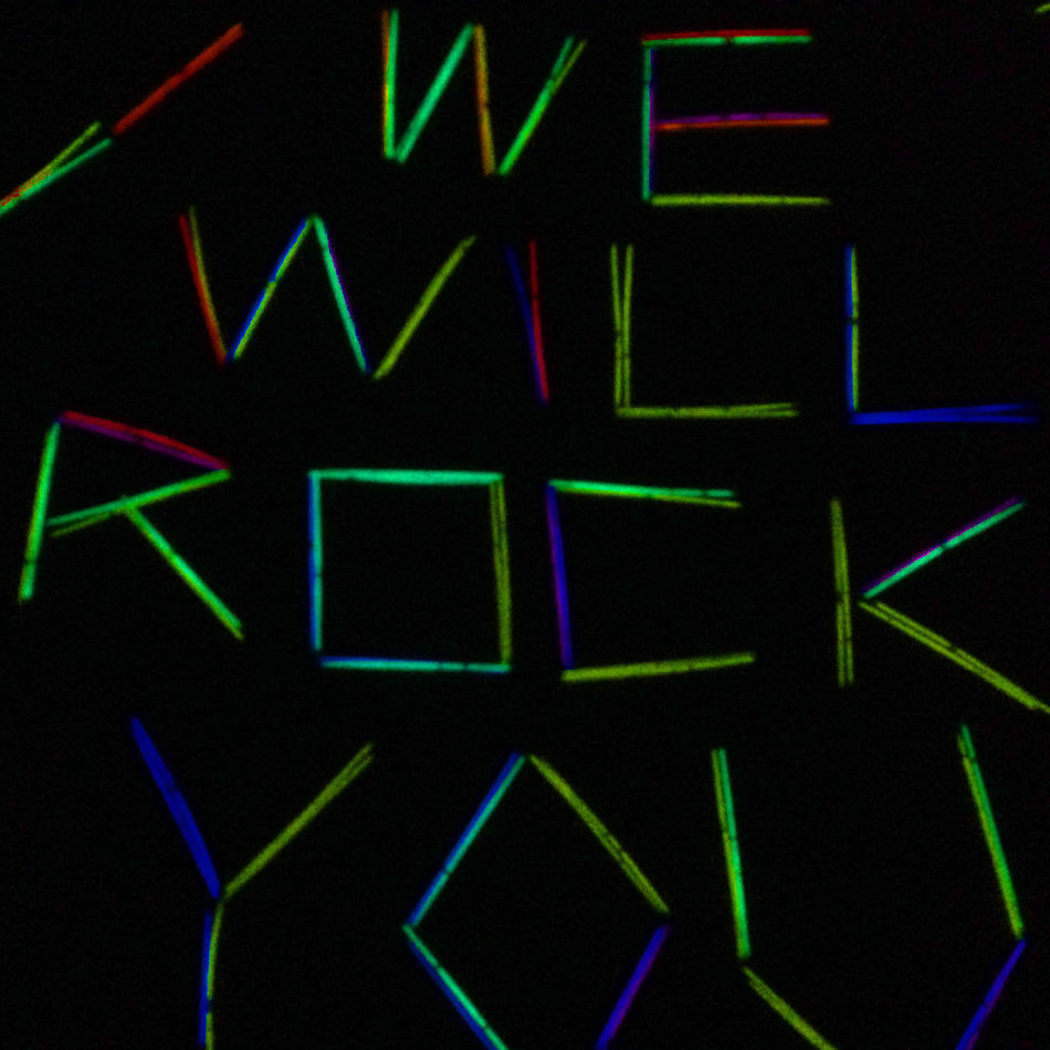 Black Background Close-up Dark Illuminated Light Stick Lightstick Mexico Modern Neon Night No People Positive Rock Type We Will Rock You Words