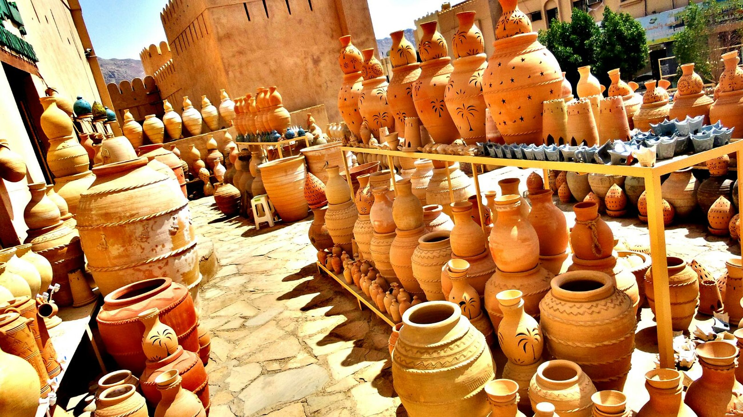 clay, art and craft, earthenware, large group of objects, variation, outdoors, for sale, day, small business, retail, workshop, no people, sculpture