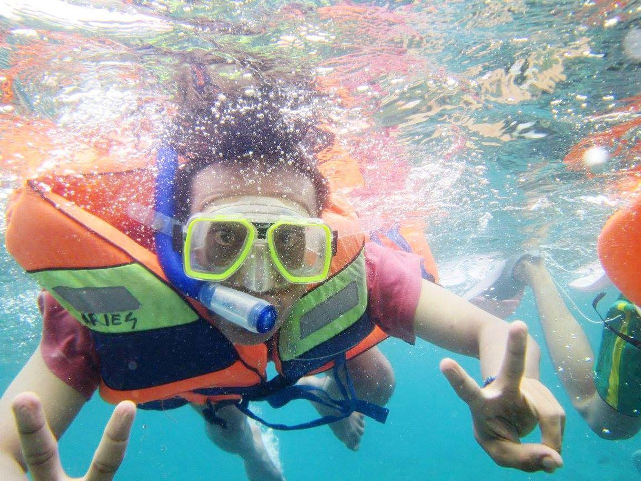 underwater, swimming, water, swimming goggles, vacations, swimming pool, scuba mask, snorkeling, portrait, scuba diving, looking at camera, leisure activity, undersea, people, adventure, one person, outdoors, young adult, close-up, young women, day, adult