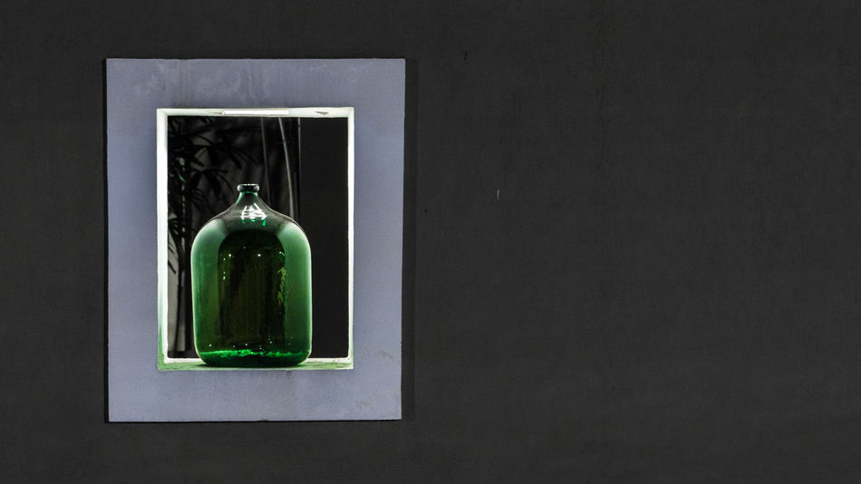 Framed Green Bottle Artistic Green Bottles Ornament Ornamental Architecture Art Photograpy Bottle Built Structure Evening Green Bottle Green Color Indoors  Interior No People Ornaments Under The Light White Windows
