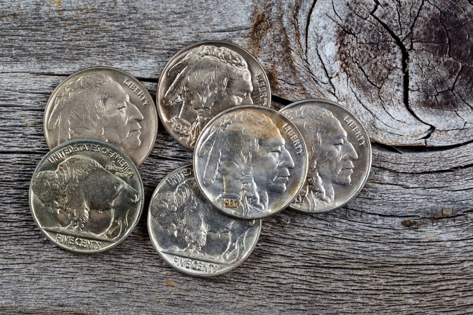 Buffalo nickels on rustic wood Abundance Buffalo Nickel Close-up Coin Day Directly Above Indian Head Indoors  Large Group Of Objects Money Nickel No People Rare Savings Table Vintage