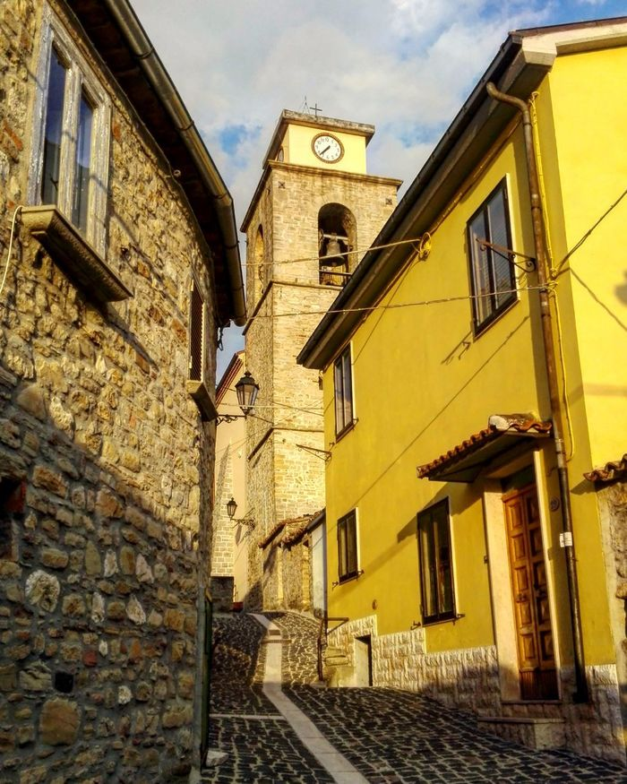 Architecture Building Exterior Built Structure Low Angle View Clock Clock Face Bell Tower Clock Tower Yellow Yellow Building Casalciprano Molise Molise Italy Italy Italia Village Life Village Stone Village Street Village Street Village Road Vıllage Borgo Antico Stone Architecture Ancient Houses