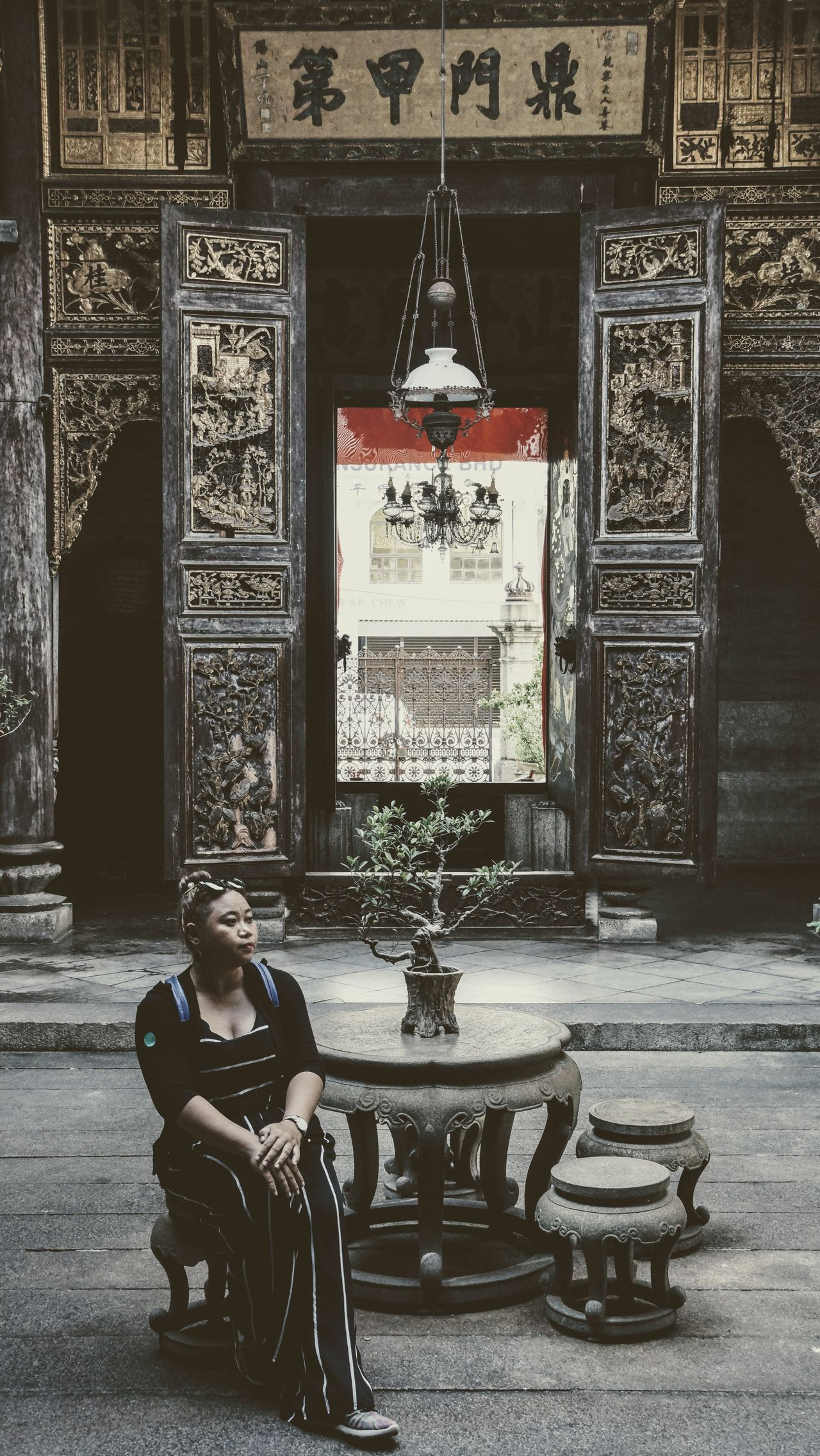 Sit tall and be confident Georgetown Penang Looking Away Penang Pinang Peranakan Mansion Architecture Building Exterior Built Structure Day Front View Full Length Indoors  Indoors  Lifestyles Malaysia One Person People Place Of Worship Real People Religion Sitting Solo Spirituality Statue Young Adult Young Women