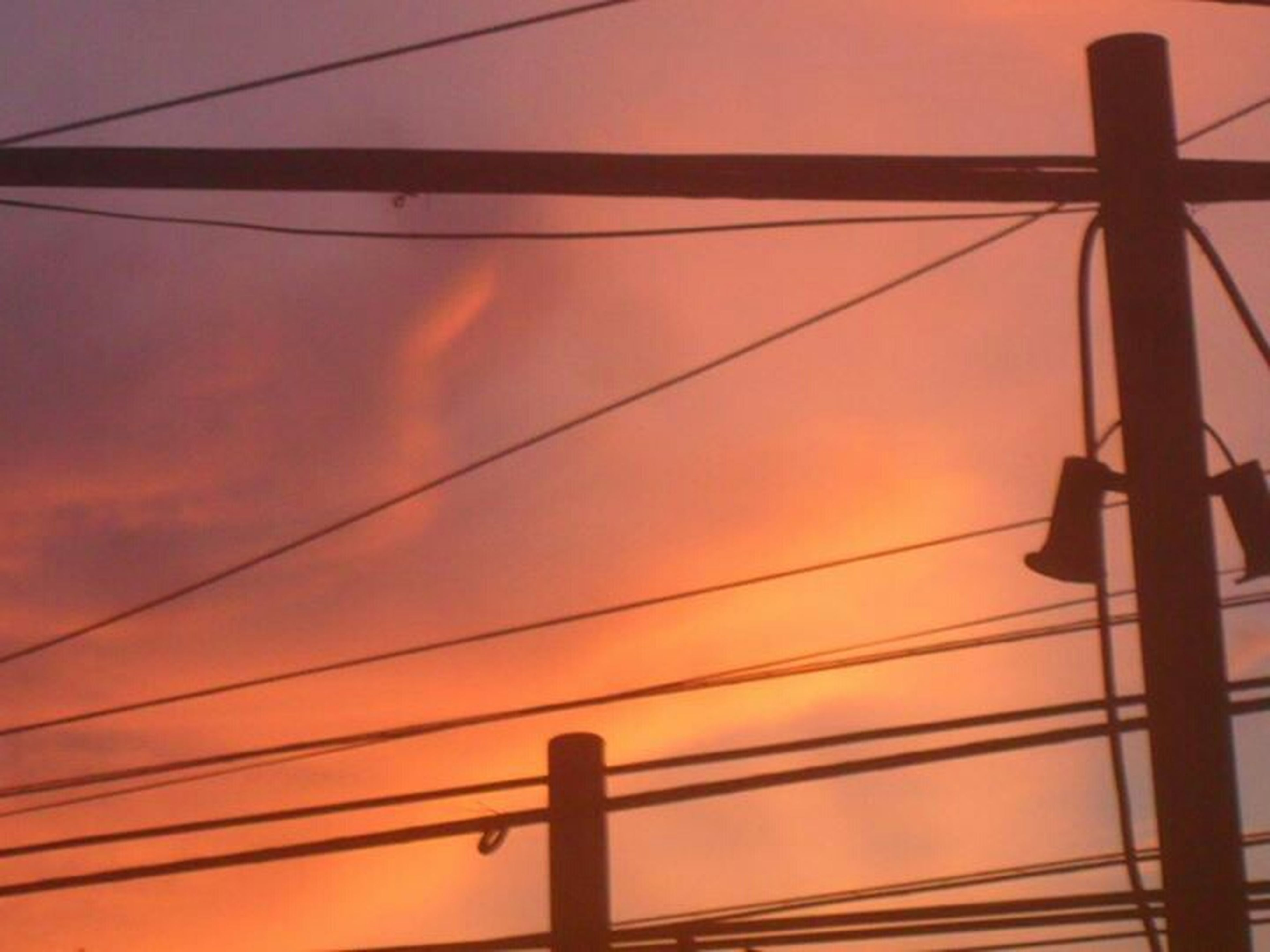 sunset, low angle view, orange color, sky, silhouette, power line, connection, cable, pole, electricity, cloud - sky, power supply, street light, sun, no people, outdoors, beauty in nature, nature, cloud, fuel and power generation