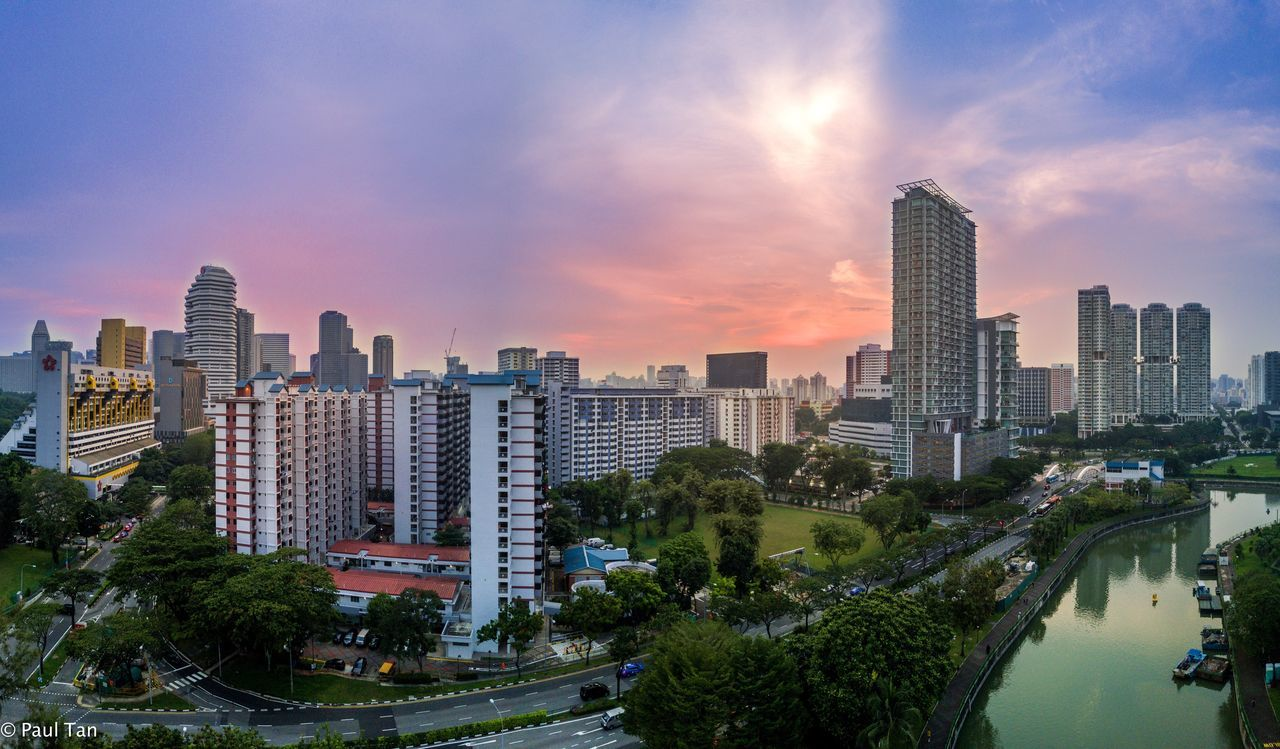 Pink sunset Skyscraper Architecture Building Exterior Cityscape Sky Sunset City Cloud - Sky Modern Built Structure Tree Urban Skyline Outdoors No People Downtown District Travel Destinations Water Nature Day