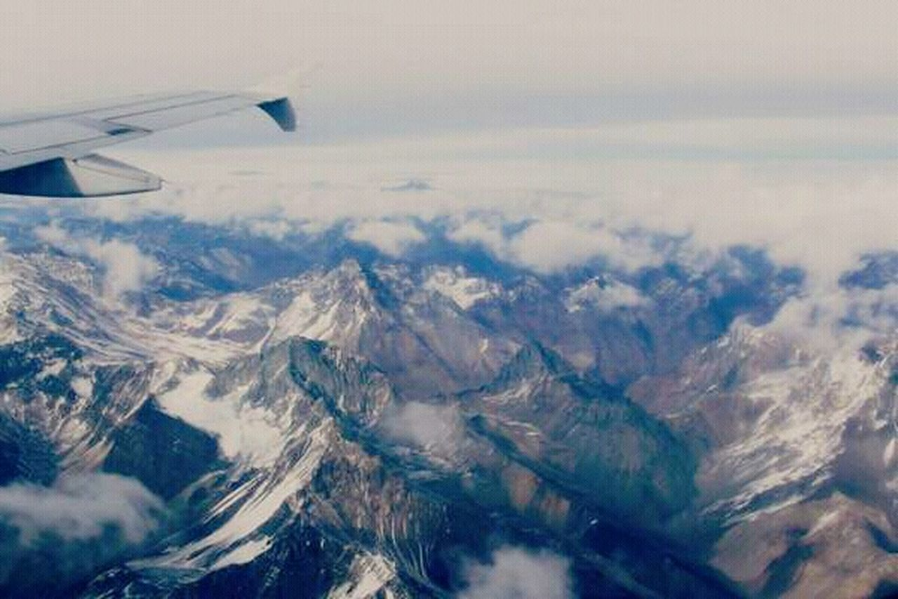aerial view, airplane, flying, landscape, transportation, air vehicle, nature, mid-air, journey, aircraft wing, mode of transport, scenics, outdoors, day, travel, no people, airplane wing, vehicle part, cloud - sky, sky, beauty in nature, mountain, view into land
