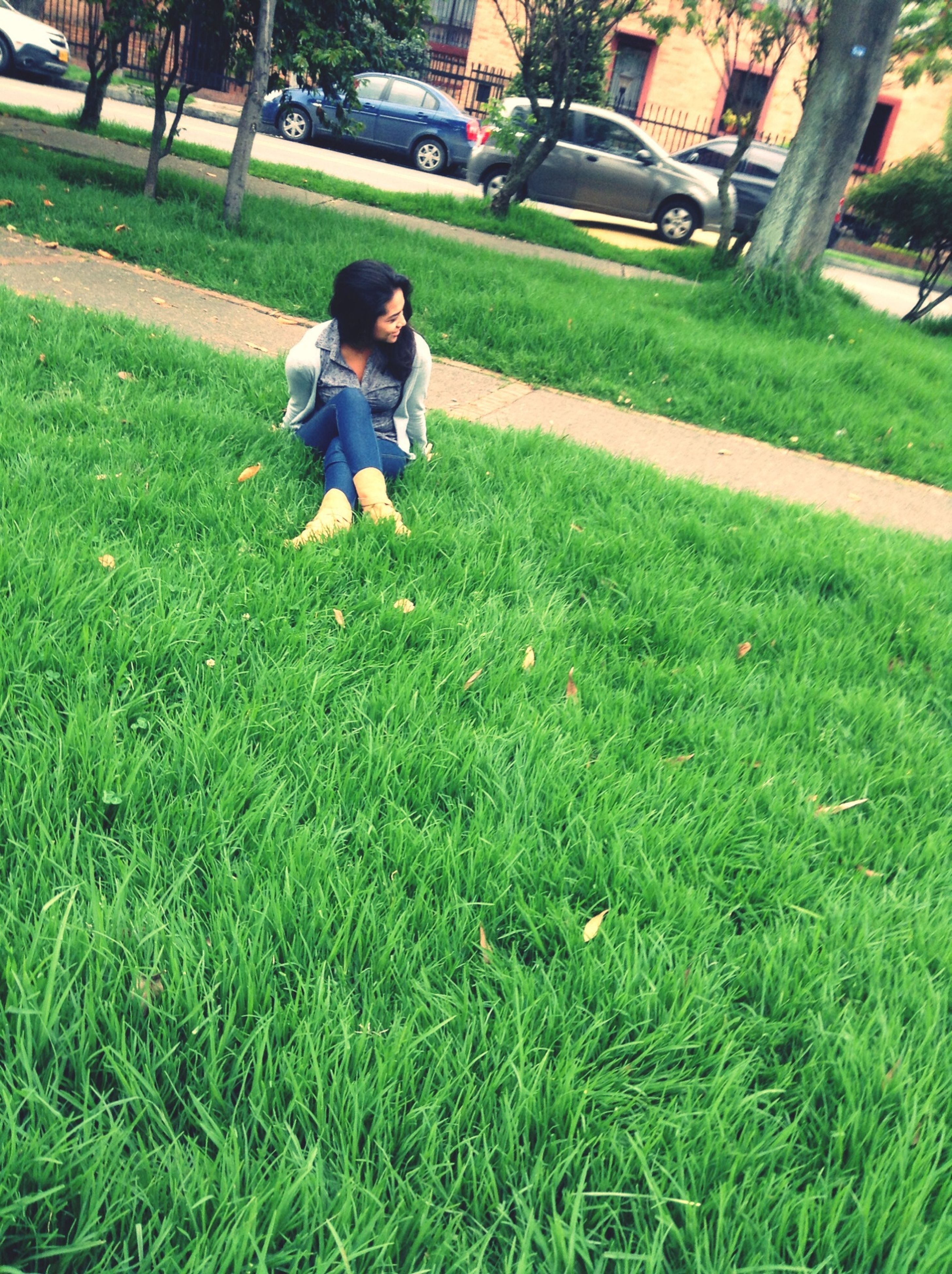 grass, full length, lifestyles, grassy, casual clothing, leisure activity, field, park - man made space, lawn, green color, person, childhood, elementary age, sunlight, park, outdoors, day, sitting