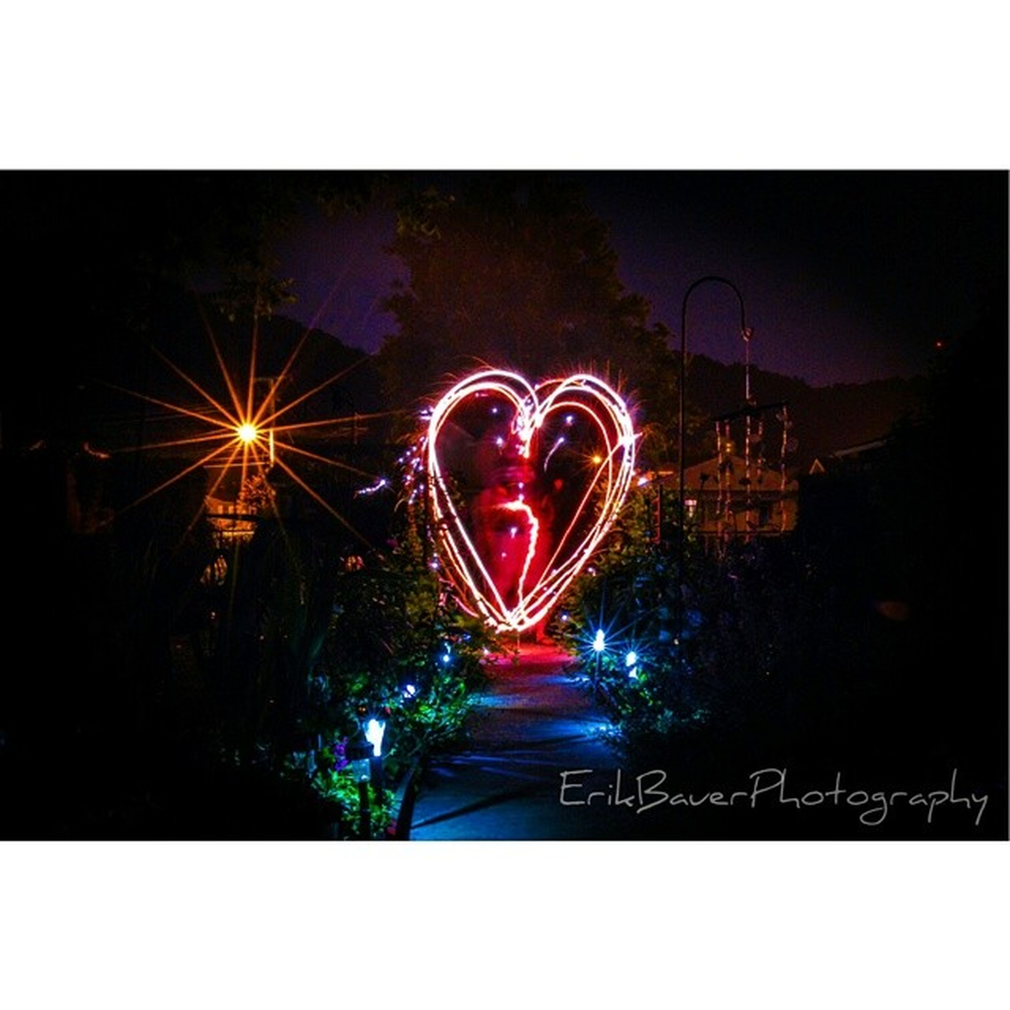 transfer print, illuminated, night, auto post production filter, long exposure, arts culture and entertainment, motion, glowing, multi colored, sky, blurred motion, celebration, water, built structure, reflection, lighting equipment, light trail, amusement park, building exterior, city