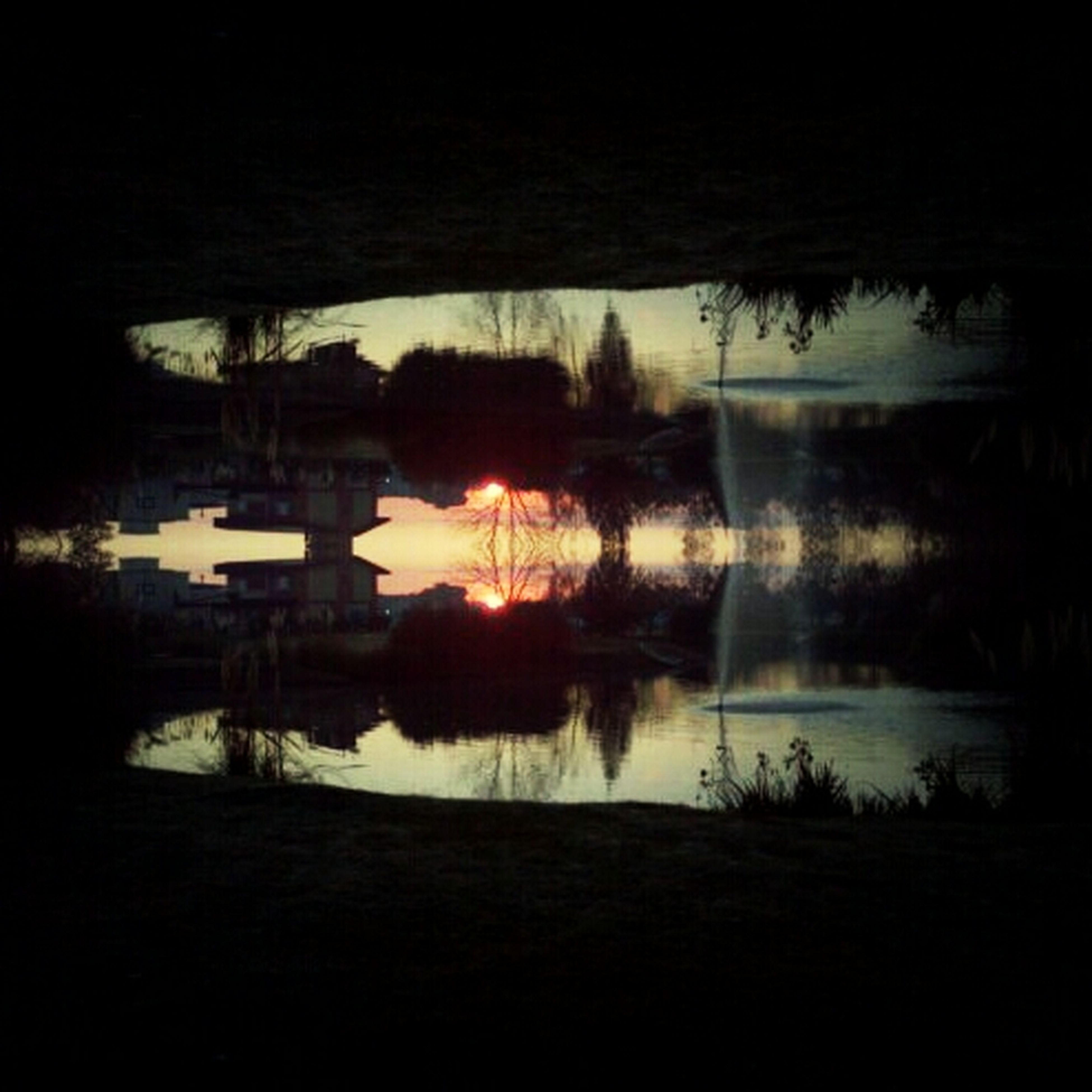 reflection, water, lake, tree, built structure, standing water, architecture, silhouette, river, sky, building exterior, tranquility, waterfront, nature, tranquil scene, pond, beauty in nature, night, scenics, no people