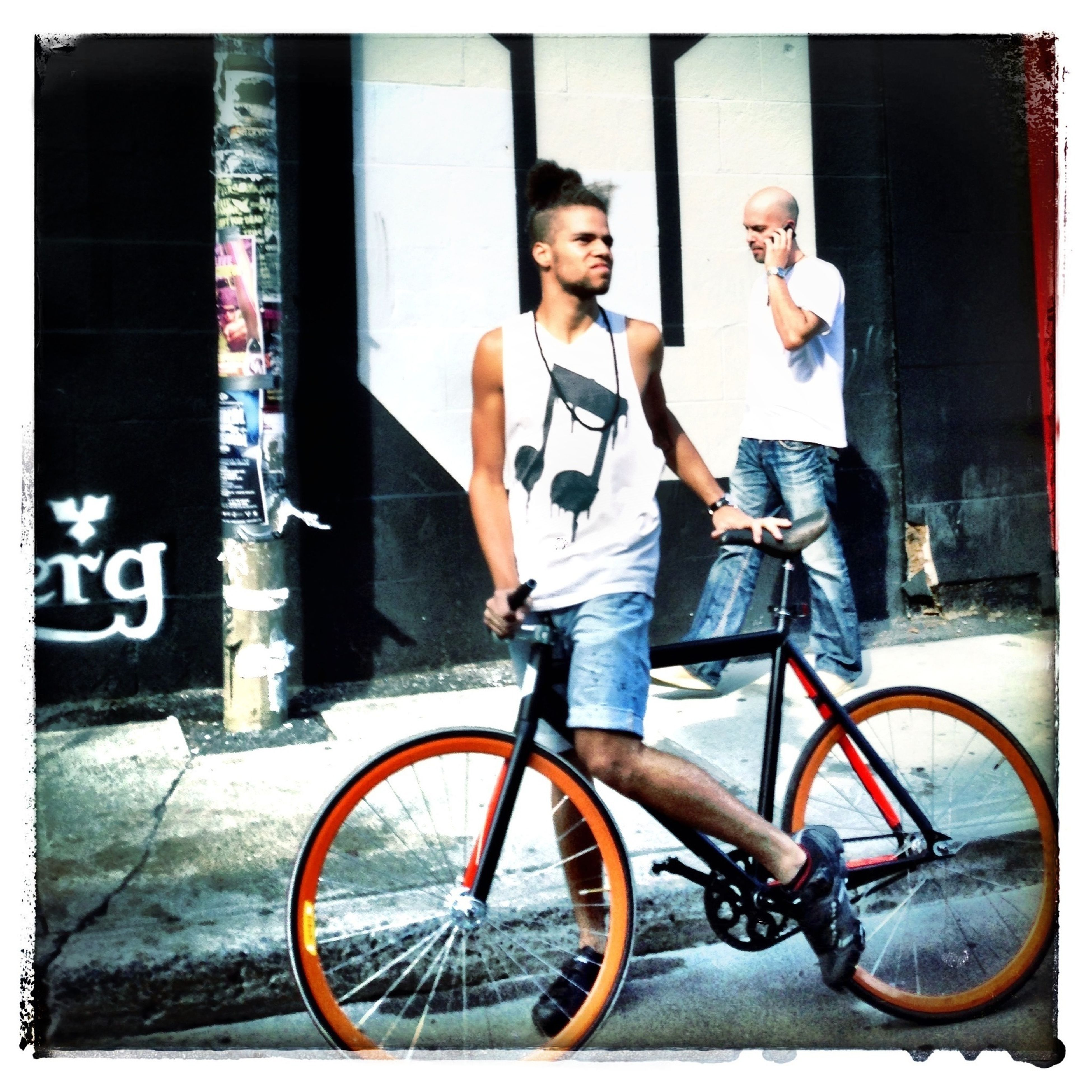 bicycle, lifestyles, full length, transportation, mode of transport, architecture, building exterior, built structure, land vehicle, casual clothing, leisure activity, wall - building feature, leaning, person, side view, auto post production filter, transfer print, street