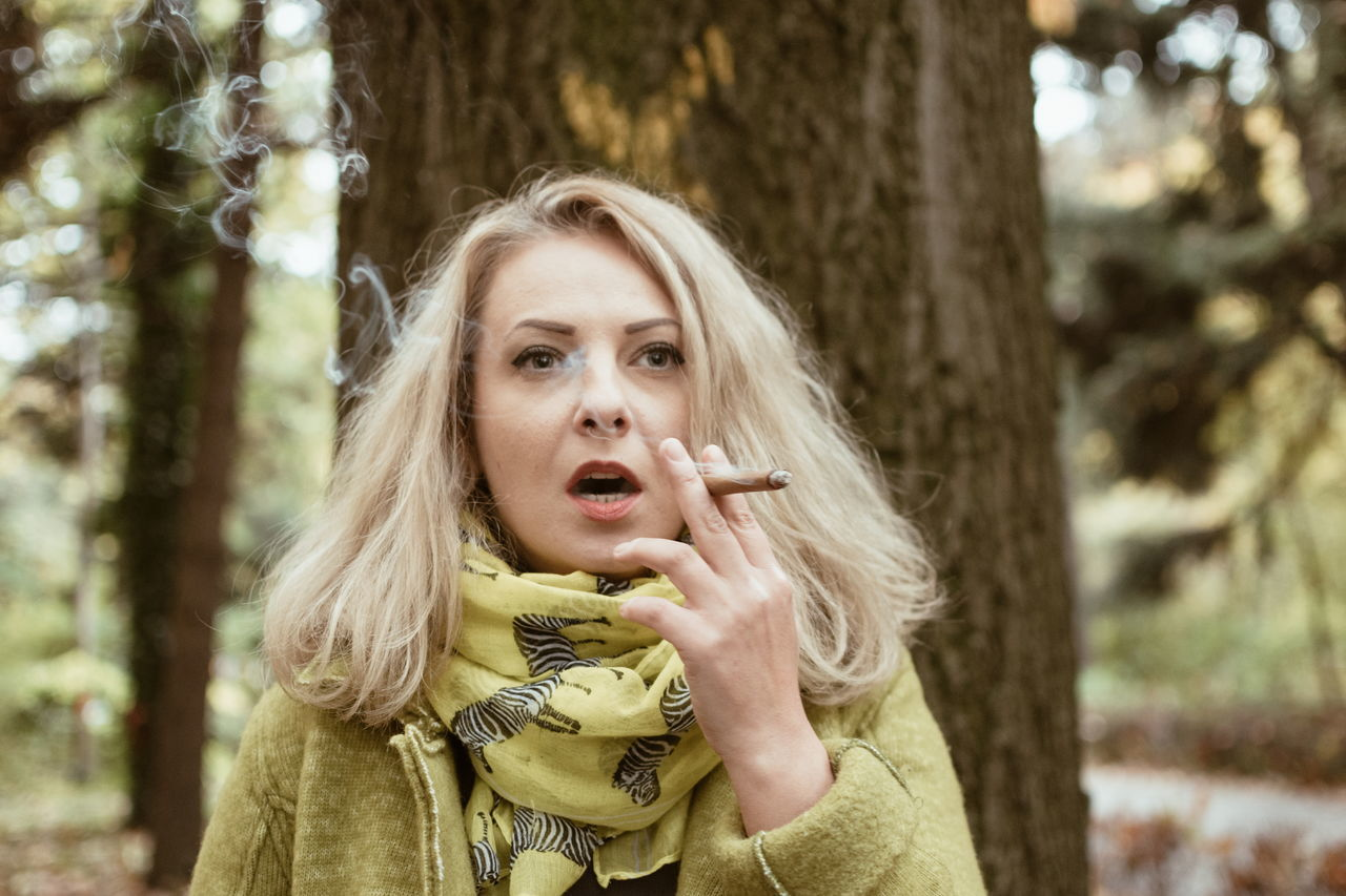 She likes to smoke, I like to smoke with her ;) Autumn Blond Hair Casual Clothing Cigar Day Focus On Foreground Forest Headshot Human Body Part Human Hand Nature One Person Only Women Outdoors Portrait Smoking Smoking Girls Tree Women Young Adult