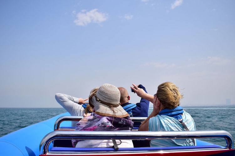 Dubai Ocean View Sightseeing Taking Photos Tourist Blue Sky Boat Ride Bonding Family Family Time Horizon Over Water Leisure Activity Lifestyles Mode Of Transport Mother Outdoors Real People Sailing Sea Selfie Togetherness Tourism Tourist Destination Transportation Vacations