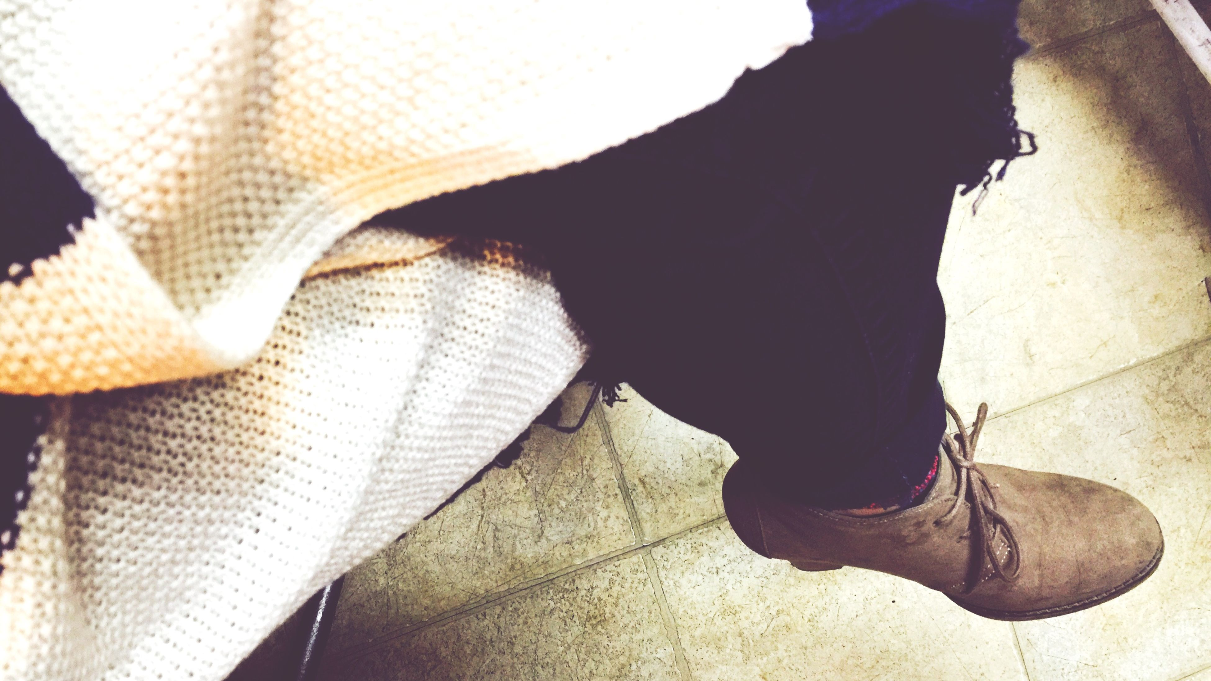 low section, shoe, person, lifestyles, standing, men, leisure activity, casual clothing, footwear, indoors, sitting, human foot, rear view, architecture, jeans, high angle view
