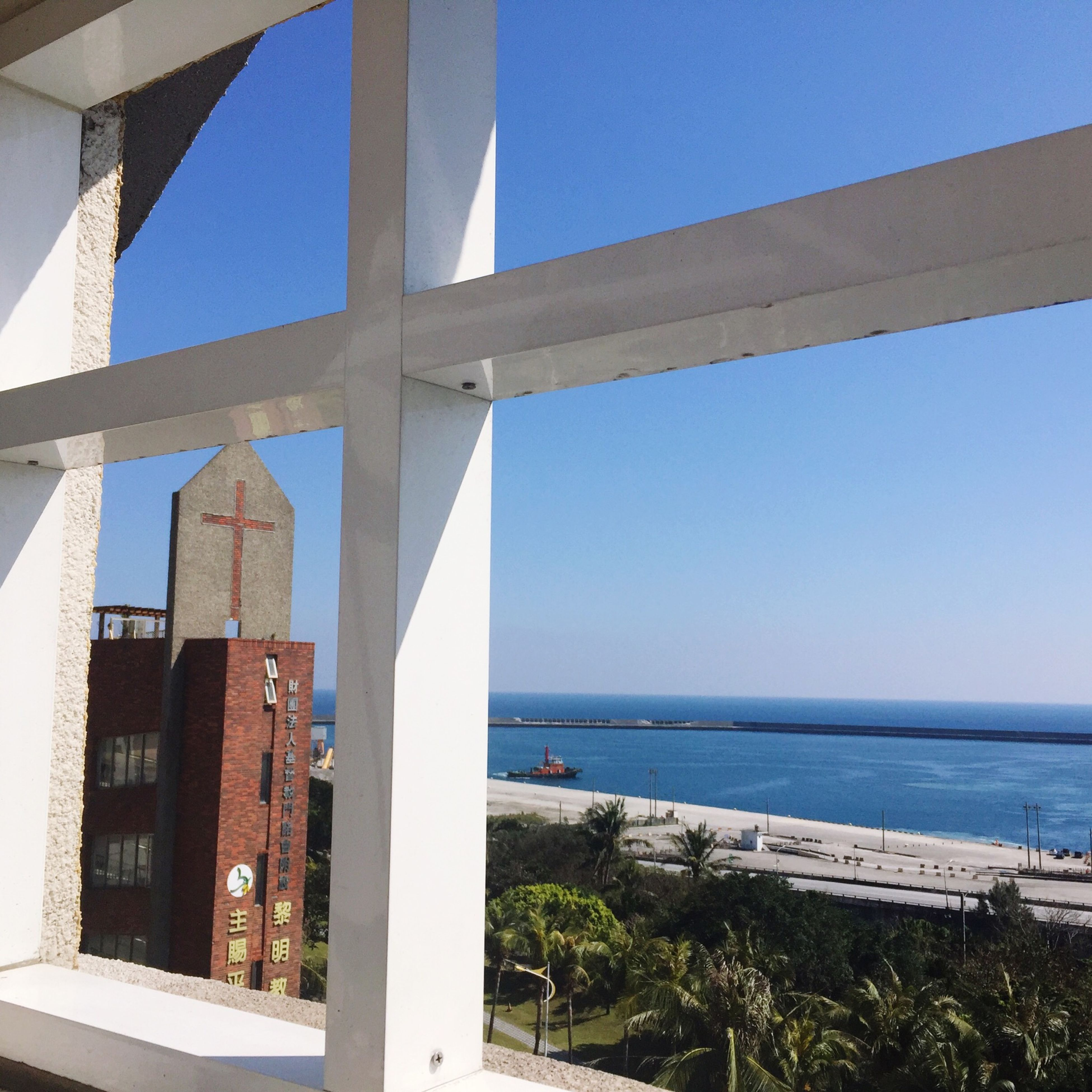 built structure, architecture, sea, horizon over water, water, beach, clear sky, building exterior, blue, sky, shore, sunlight, day, sand, nature, outdoors, architectural column, no people, scenics, coastline