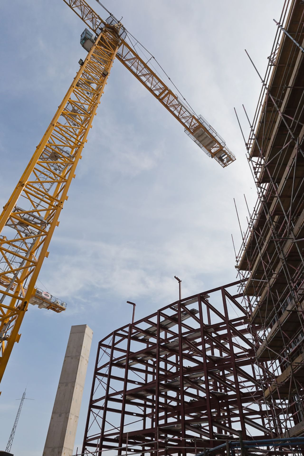 Construction Site Architecture Building Exterior Built Structure Construction Construction Frame Construction Machinery Construction Site Crane Crane - Construction Machinery Day Development Girder Industry Low Angle View Metal No People Outdoors Progress Sky Technology