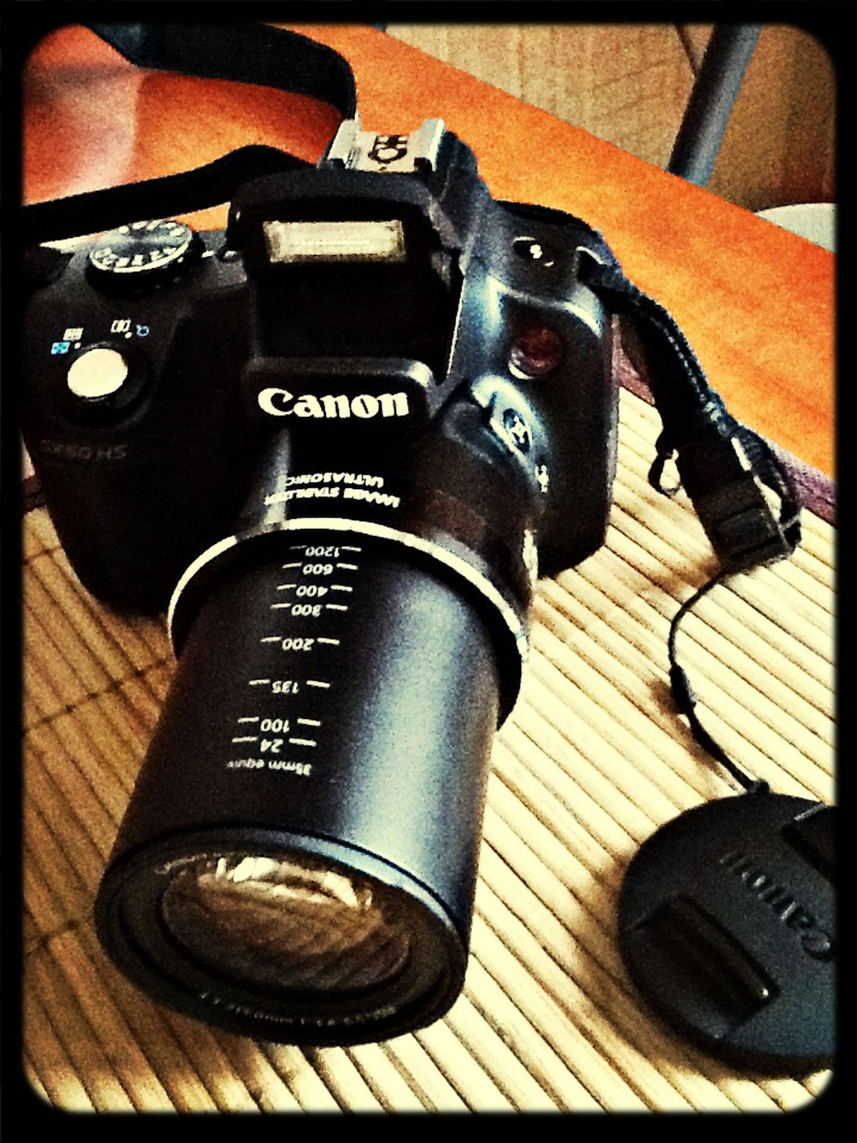 technology, indoors, close-up, old-fashioned, transfer print, retro styled, music, still life, auto post production filter, equipment, musical instrument, high angle view, arts culture and entertainment, metal, photography themes, part of, communication, camera - photographic equipment, musical equipment, vintage