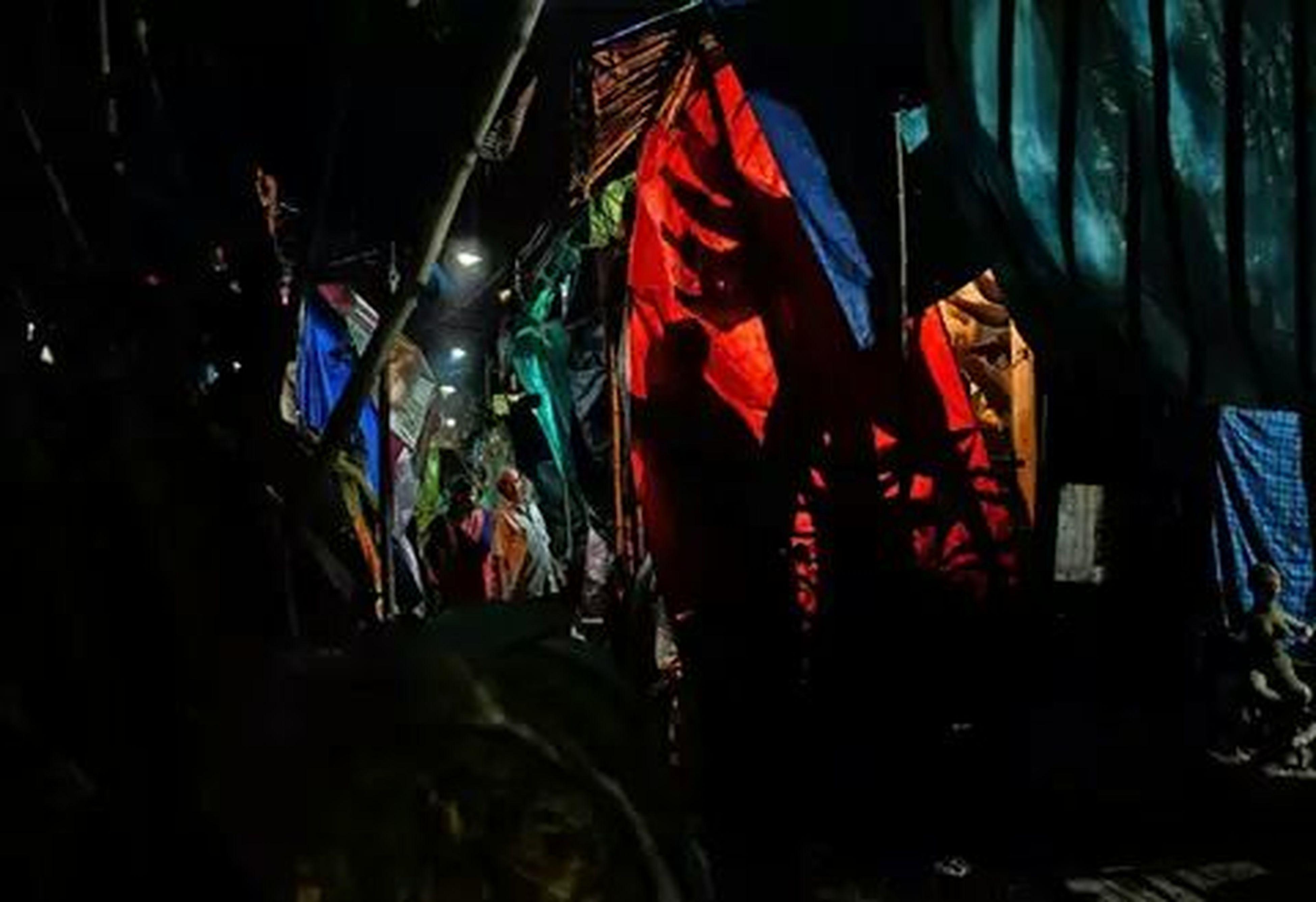 night, illuminated, multi colored, lighting equipment, street, flag, art, red, art and craft, creativity, dark, celebration, built structure, outdoors, city, light - natural phenomenon, building exterior, human representation, decoration, hanging