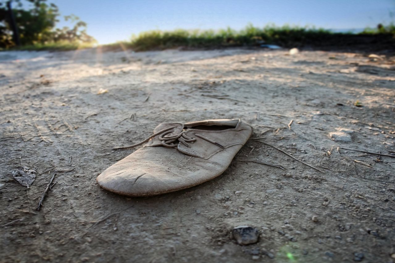 Outdoors No People Beach Sand Day Nature Close-up Old Shoe Abandoned Still Life Still Life Photography Focus On Foreground Low Angle View Old Shoes Discarded Lost And Forgotten Runover Flattened Depth Of Field Miles Away Lost And Found Abandonado