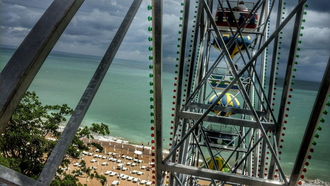 sea, water, metal, sky, day, outdoors, no people, built structure, arts culture and entertainment, beach, amusement park, horizon over water, nature, architecture, close-up