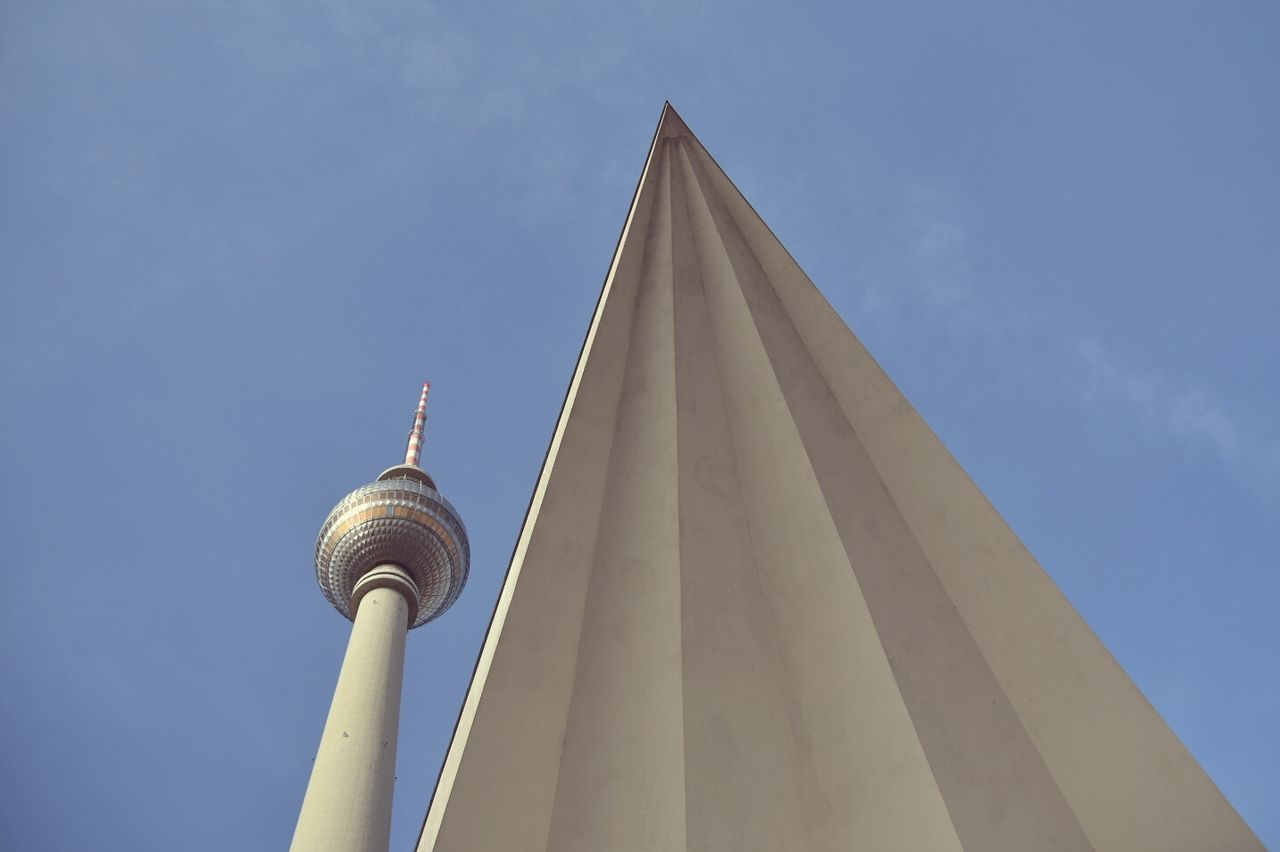Architecture Low Angle View Travel Tower Travel Destinations City Tourism High Section Blue Communication No People Outdoors Built Structure Futuristic Symbol Sky Day Clock Face Clear Sky TV Tower Berlin City