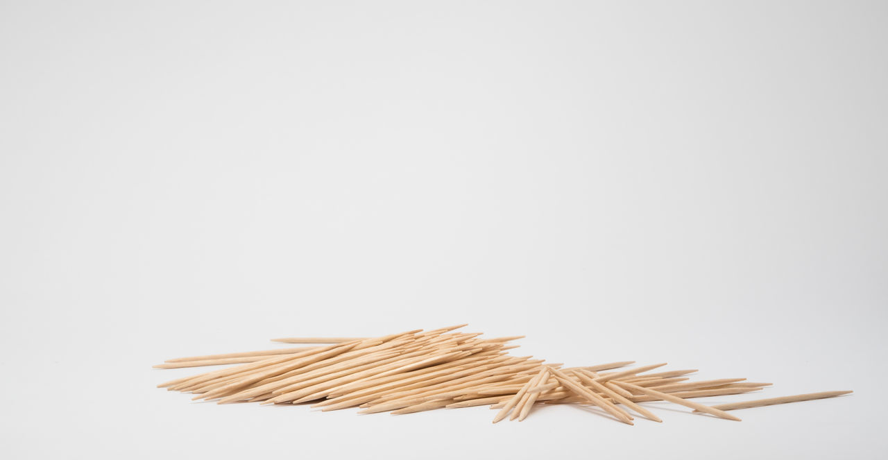 Pile of toothpicks Batch Close-up Heap Large Group Of Objects Mass No People Pile Studio Shot Toothpick Toothpicks White Background Wood - Material