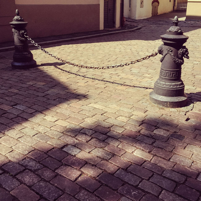 Vecriga Old Town Riga Architecture Building Exterior Chain Cityscape Footpath Latvia No People Old Town Parked Paving Stone Pedestrian Pedestrian Walkway Riga Sidewalk Sightseeing Stone Town Square Vecriga Walking