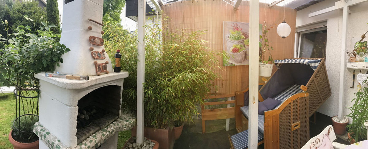 Panorama from a reconsidered terrace Home Terrace Architecture Bamboo Basket Chair Building Exterior Chair Covered Day Fireplace FreeTime Garden Garden Stove Growth Huge Grill Interior Lens Flares No People Outdoors Plant Potted Plant Reconsidered Roofed Roses Summer