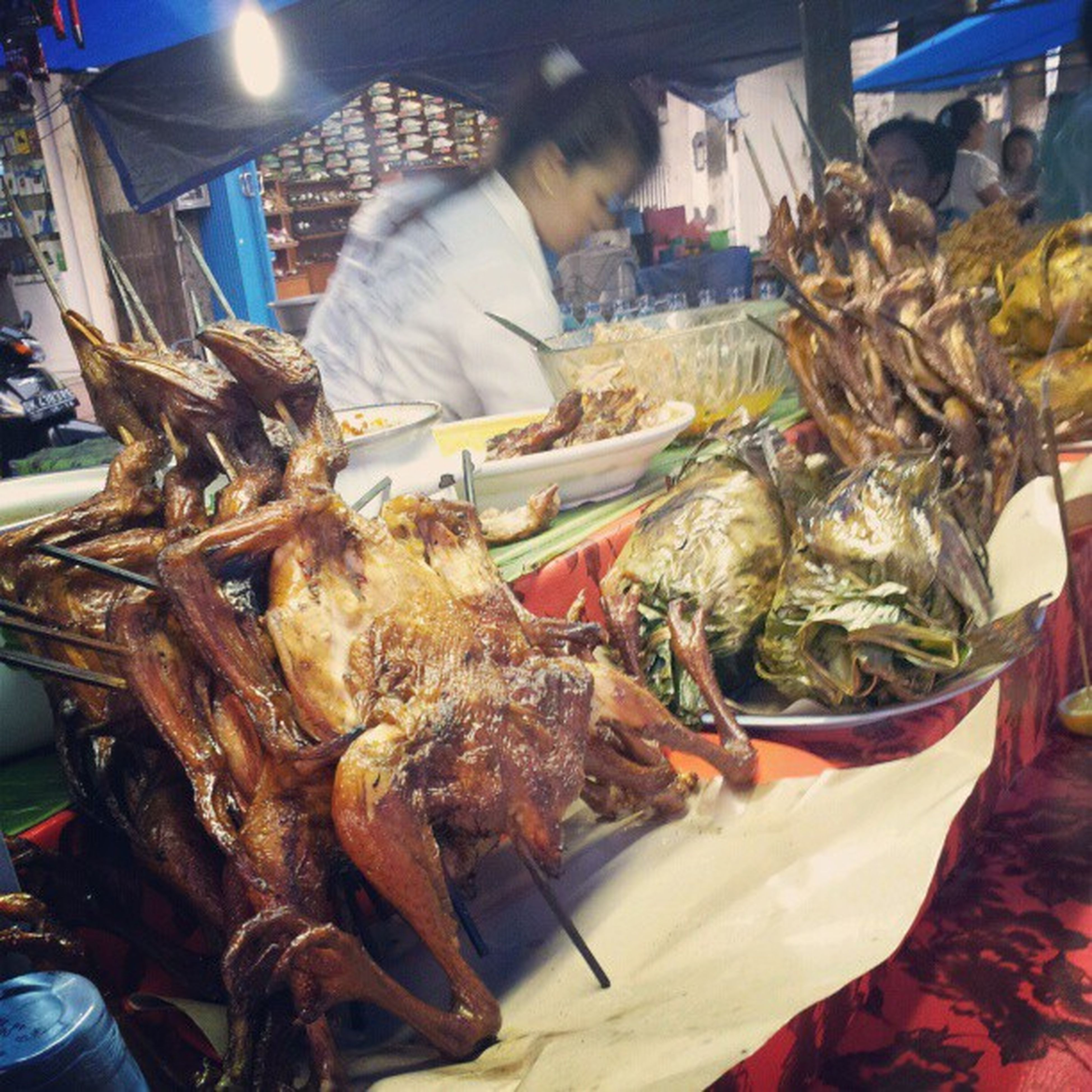 food and drink, food, seafood, meat, healthy eating, freshness, fish, indoors, men, preparation, incidental people, retail, grilled, market, market stall, preparing food, prawn, barbecue grill