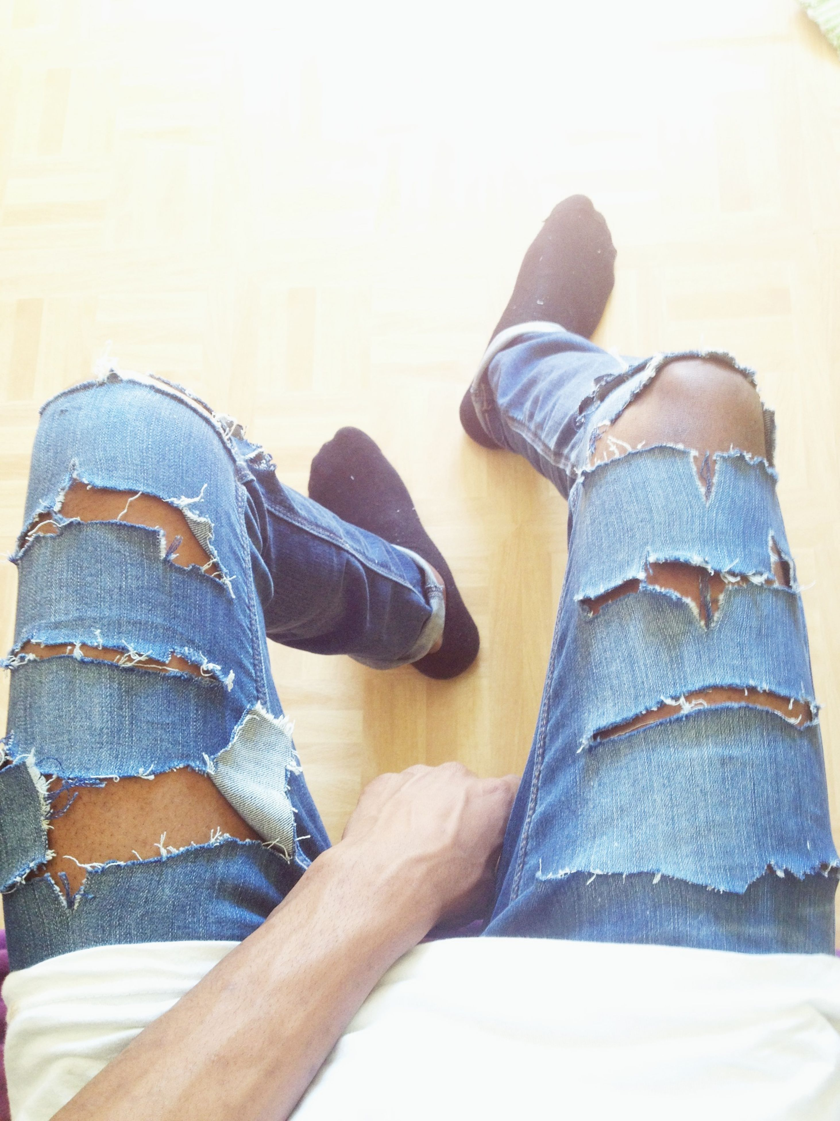 low section, person, shoe, jeans, lifestyles, casual clothing, standing, relaxation, leisure activity, footwear, sitting, human foot, personal perspective, indoors, men, blue, denim