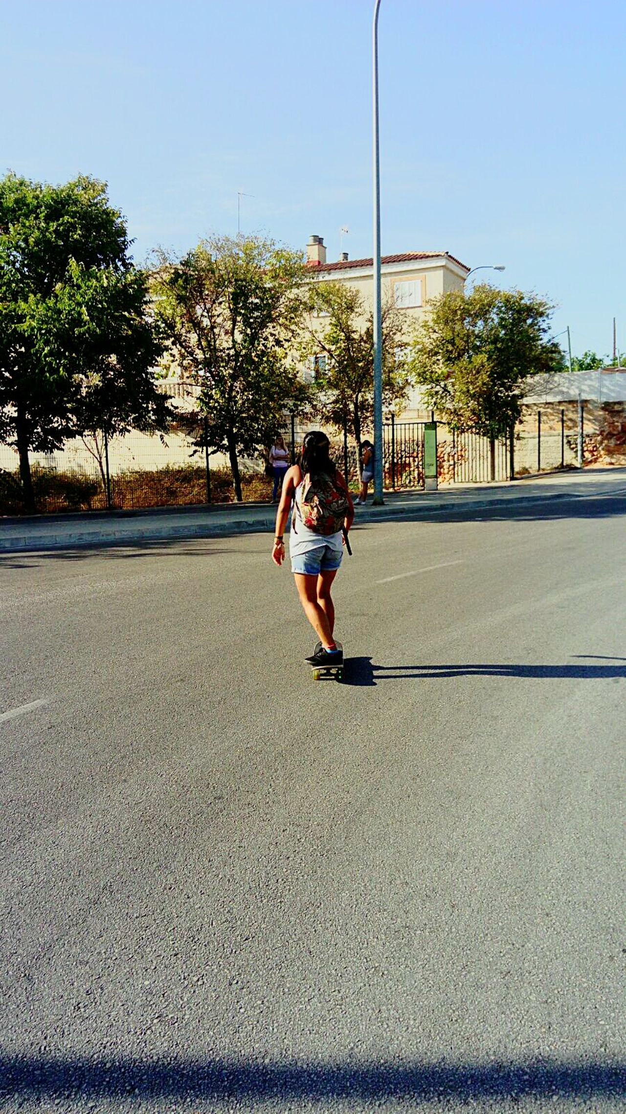 Skateboarding Funny Sk8orDie Skater Girl Full Length Tree Walking Casual Clothing Leisure Activity Lifestyles Shadow Skateboarding Road Clear Sky Day Sunny Sky Enjoyment Person Outdoors Young Adult Blue First Eyeem Photo