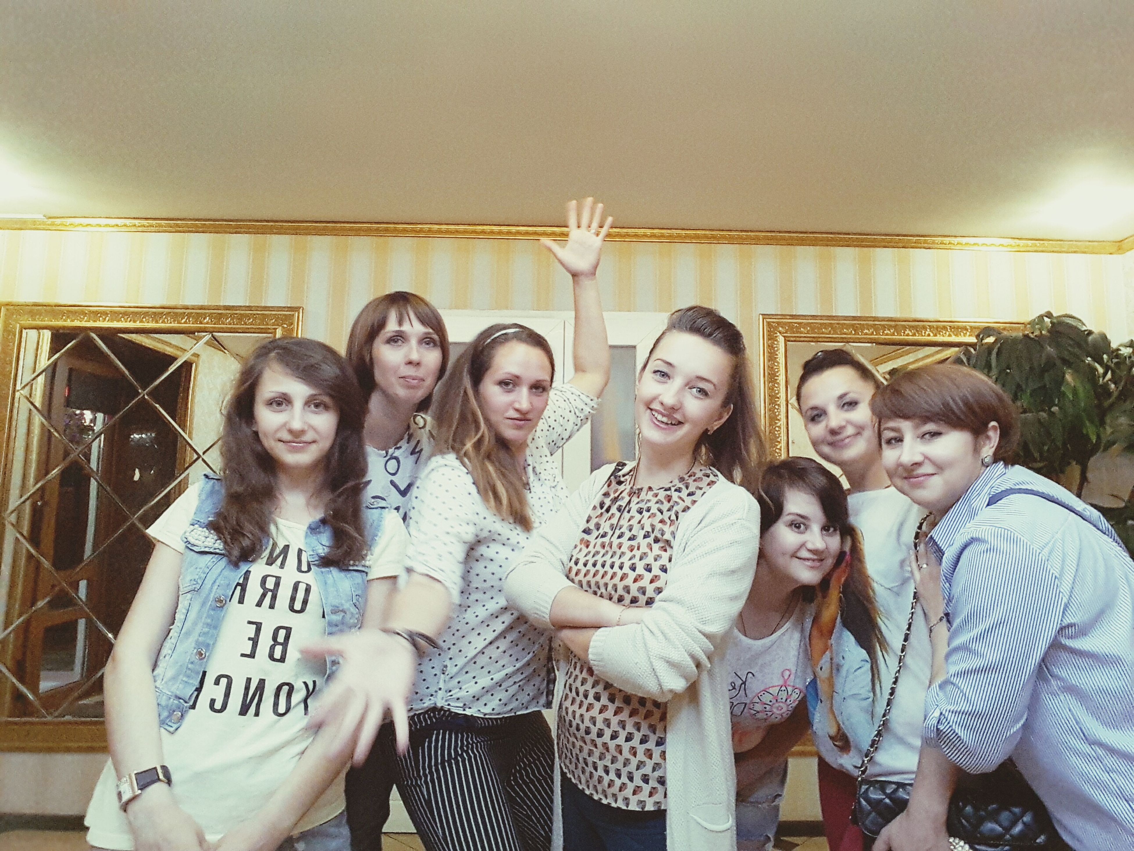smiling, friendship, togetherness, fun, standing, bonding, leisure activity, young women, happiness, real people, looking at camera, young adult, cheerful, portrait, indoors, day