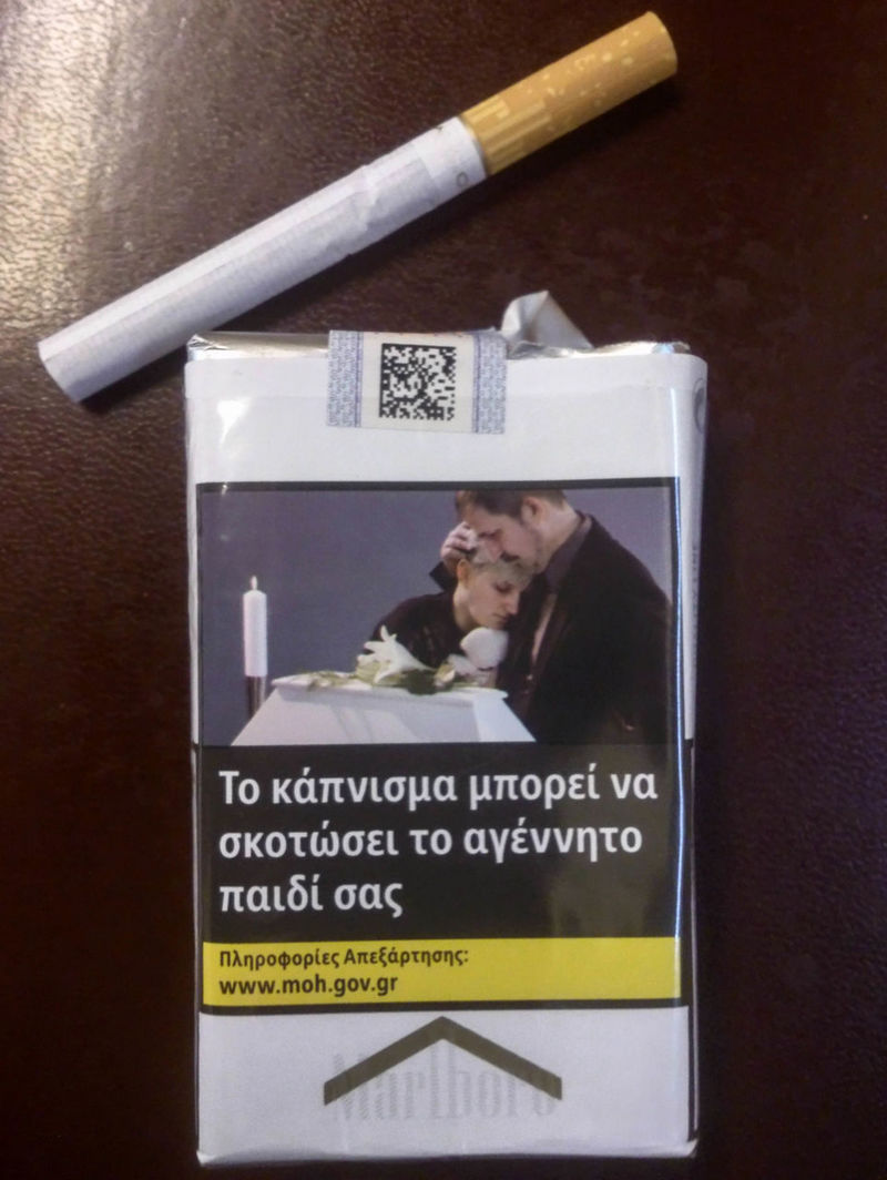 Greek cigarette packet with public health warning - smoking kills Cancer Cigarettes Death Public Health Campaign Smoking Addiction Cigarette Packet Cigs Close-up Communication Culture Customs Dangerous Message Tabacco  Text Unhealthy Lifestyle Warning