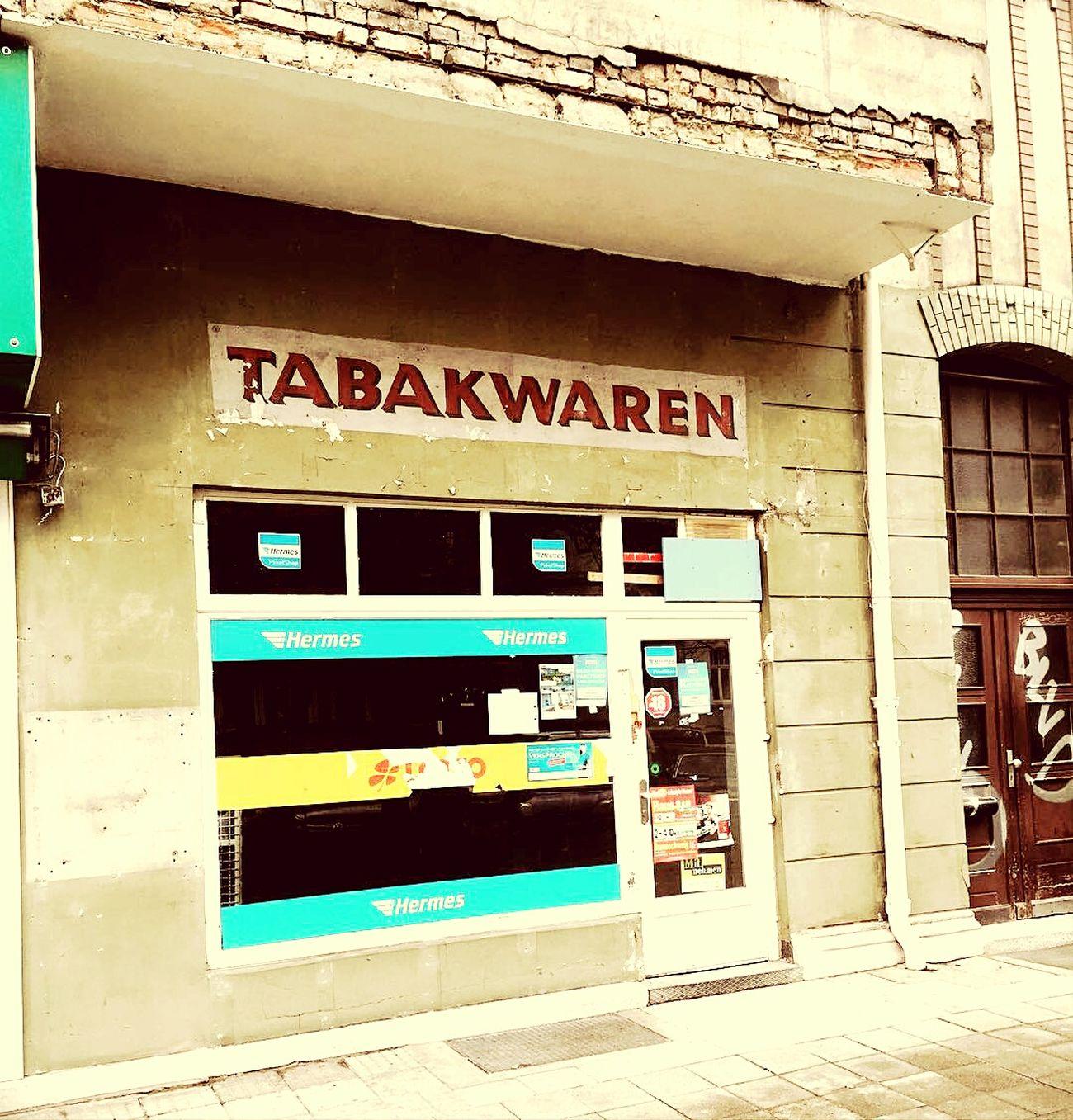 Discovering unseen layers of history Newsagent's Tobacco Shop Refurbishment Vintage Shop Kiosk Shop Sign Braunschweig Brunswick