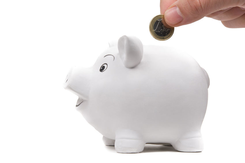 Man's hand inserts one euro coin in a piggy bank. Isolated on white Business Growth Isolated Rich Abundance Account Asset Banking Cash Coin Concept Deposit Earnings Euro Finance Financial Human Hand Investment Money Piggy Bank Retirement Savings Wealth Wealthy White Background
