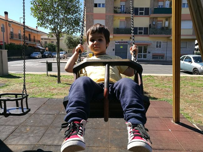 Playground Childhood Child Outdoor Play Equipment Playing Day One Person Outdoors Swing Leisure Activity Boys People Real People Built Structure Sitting Hanging Children Only City Color Photography The Purist (no Edit, No Filter) Outdoor Photography Casual Clothing Altalena 😁 Altalena
