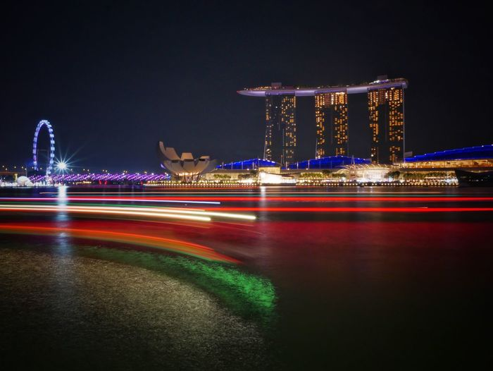 Night Illuminated Long Exposure Light Trail Motion Speed Building Exterior Travel Clear Sky Architecture Outdoors City Travel Destinations Blurred Motion No People Road Built Structure Singapore View Marina Bay Sands