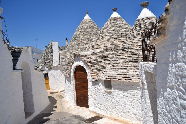 Alberobellophotocontest Architectural Feature Architecture Blue Building Exterior Built Structure Day Exterior Façade Houses And Homes Landmarkbuildings Low Angle View No People Outdoors Outside Place Of Worship Puglia Roof Semplicity Sky Streetphotography Sunlight The Past Travel Destinations Trulli Houses