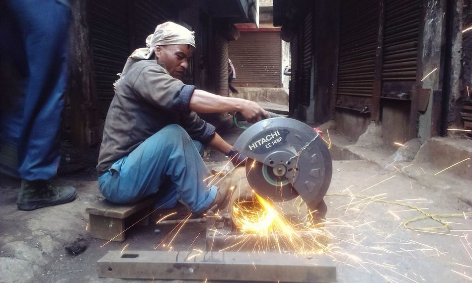 Envision The Future Old To New Recycling Imrankhaan People Collection Imrankhaan Potrait Men At work Cutting with Metal to another Metal :)