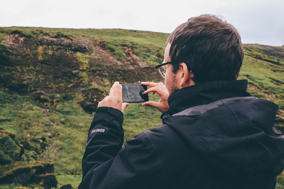Casual Clothing Geology Green Iceland Landscape Man Man Taking Photo Moss Nature Nature Photography Outdoor Outside Person Perspective Phone Real People Taking Photos Of People Taking Photos