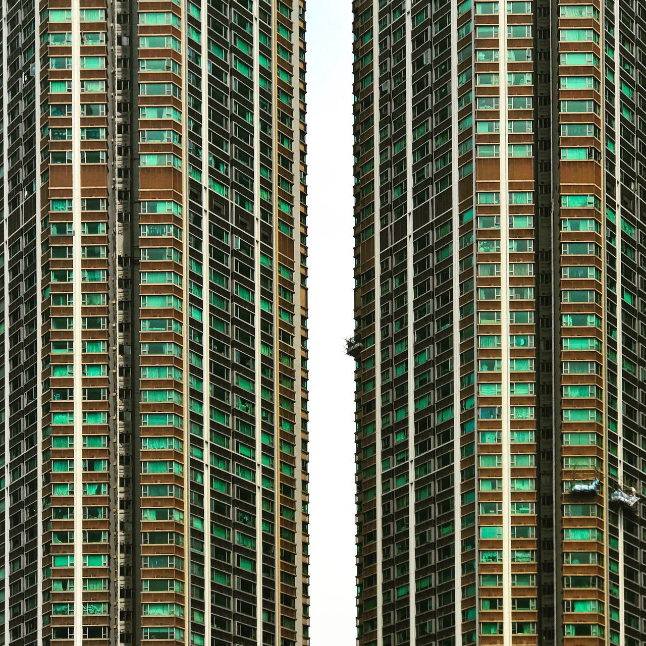 Skyscraper Building Exterior Architecture City No People Outdoors Day Residential Building Urban Geometry Dense Living Hong Kong Low Angle View Urban Lifestyle Facades City Life Urban Residential Structure