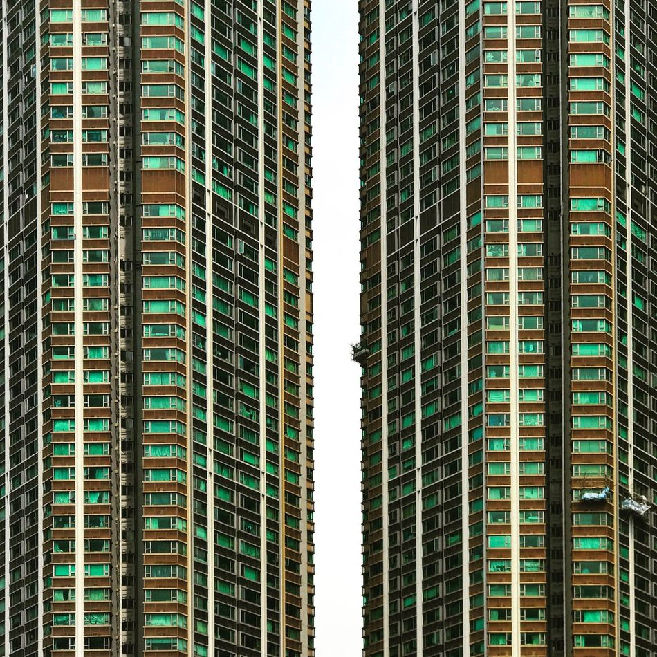 Skyscraper Building Exterior Architecture City No People Outdoors Day Residential Building Urban Geometry Dense Living Hong Kong Low Angle View Urban Lifestyle Facades City Life Urban Residential Structure The Week On EyeEm The Secret Spaces