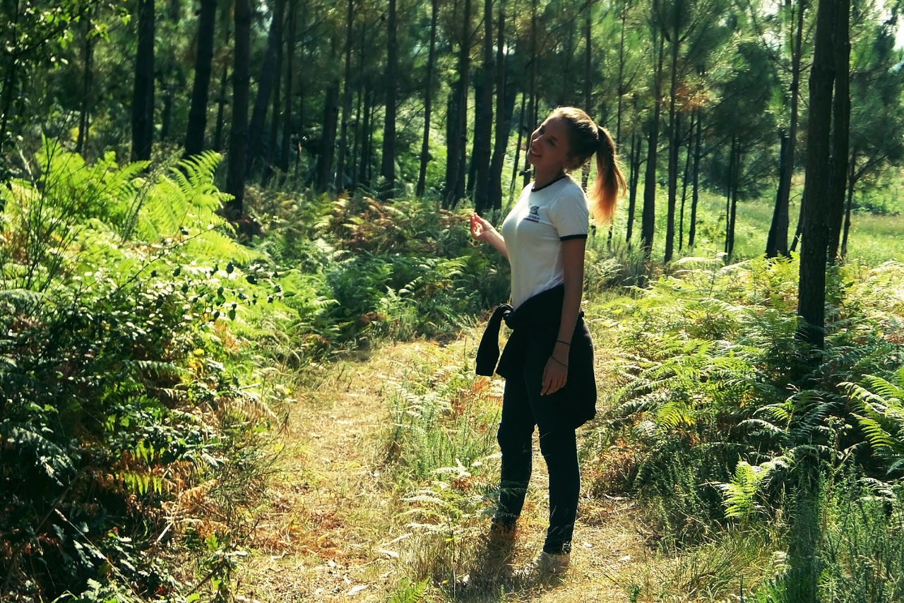 tree, forest, real people, full length, one person, nature, standing, growth, casual clothing, young adult, leisure activity, young women, walking, lifestyles, day, outdoors, plant, tree trunk, beauty in nature, scenics, beautiful woman