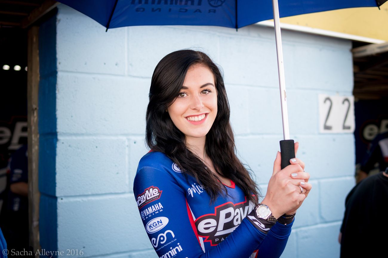 Smiling Only Women Portrait Cheerful Person Headshot Happiness Young Women One Woman Only Young Adult One Person Females People Close-up One Young Woman Only Gridgirls Beautiful Brunette Pitlane Grid Girl Britishsuperbikes Blue Brown Hair Looking At Camera