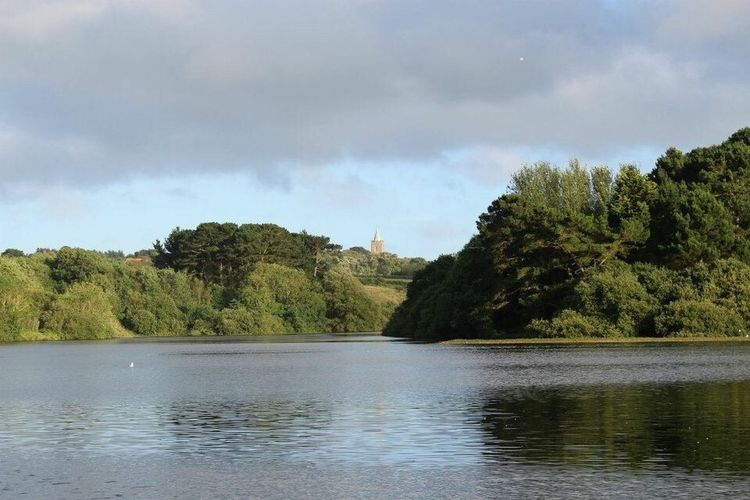 View over St Saviour's reservoir, Guernsey Reservoir St Saviours Guernsey Island Channel Islands Water Tree Sky Tranquil Scene Tranquility Beauty In Nature Cloud Nature Cloudy Idyllic Day Calm Outdoors Landscape Tourism Green Non Urban Scene Remote Weather