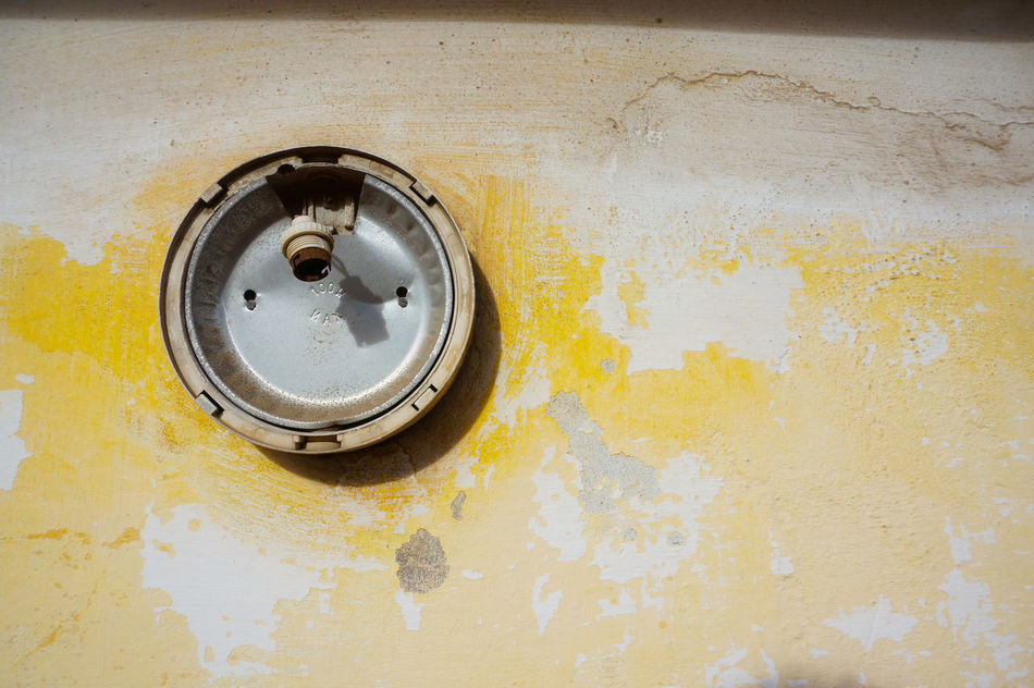 For the U N T I T L E D series 💡 Abandoned Lamp Decayed On The Wall MnMl Mnmlsm Minimalism Minimal Minimalistic Minimalmood Minimalist Minimalobsession Minimalart Minimalarchy Yellow Shades Of Yellow Yellowish What Is Left To Explore Debris Lieblingsteil Remains Beauty Of Decay Detritus Detritus Series Time Effect