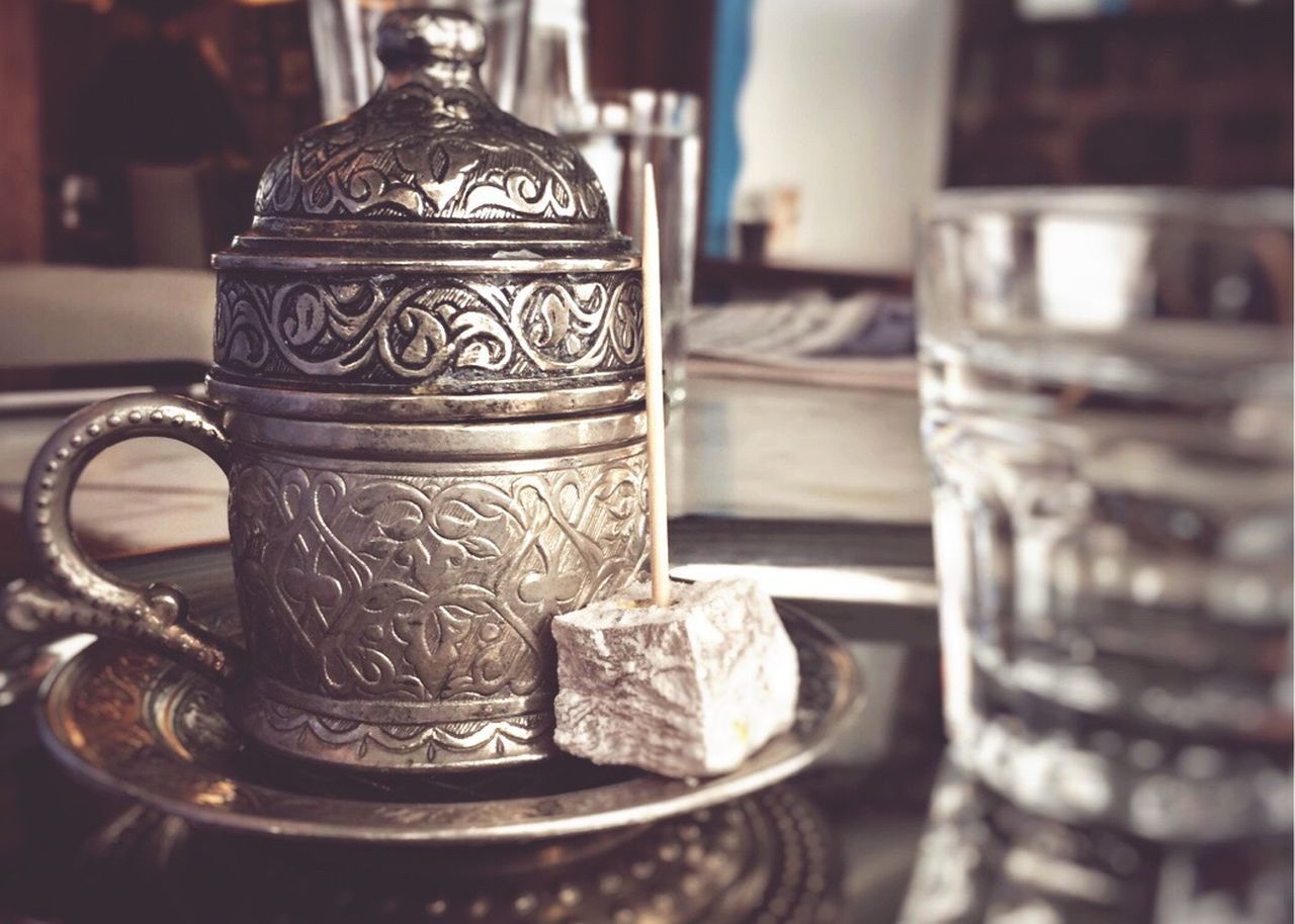 Traditional very strong Turkish coffee in a cup served with a glass of cold water and a Turkish delight powerdered with sugar next to it. Indoors  Close-up Table Silver Colored No People Ornate Focus On Foreground Antique Drink Turkish Delight Sweets Cafe Turkey Tin Closeup close up Close Up Rich Day Coffee Turkish Coffee Strong Traditional Decorated Cup