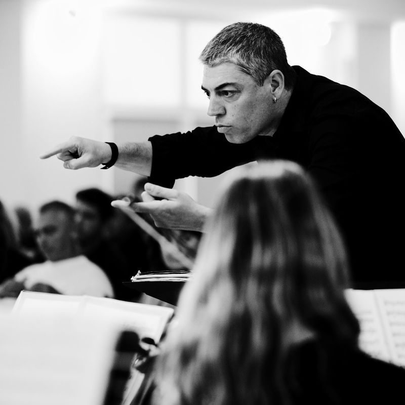 Classical Music Music Director Adult Auditorium Blackandwhite Coach Day Guidance Human Hand Indoors  Men Occupation People Professor Real People