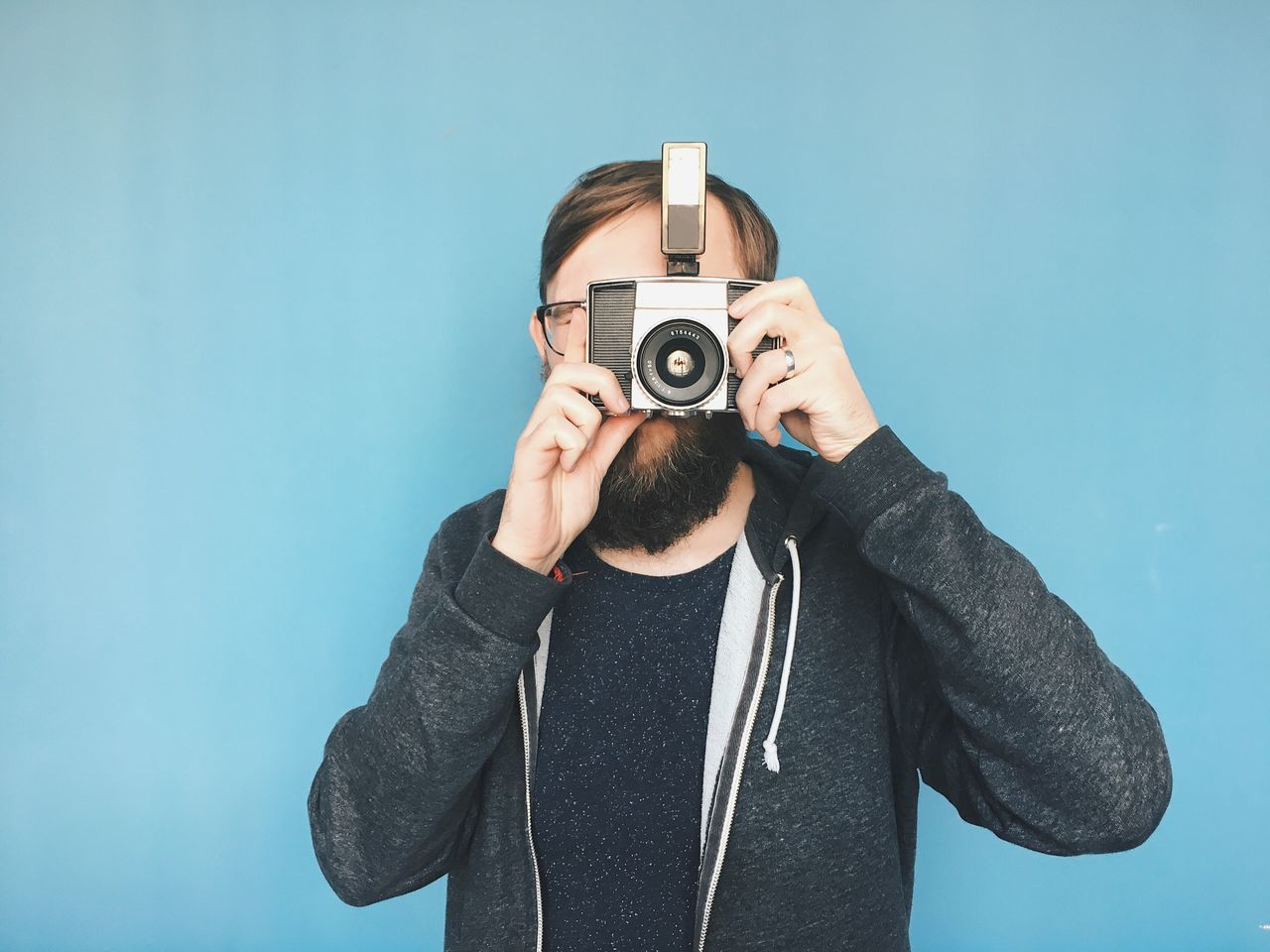 Camera - Photographic Equipment Photography Themes Holding One Person Photographing Old-fashioned Casual Clothing Looking Through An Object Technology Photographer Young Adult Portrait Analogue Photography