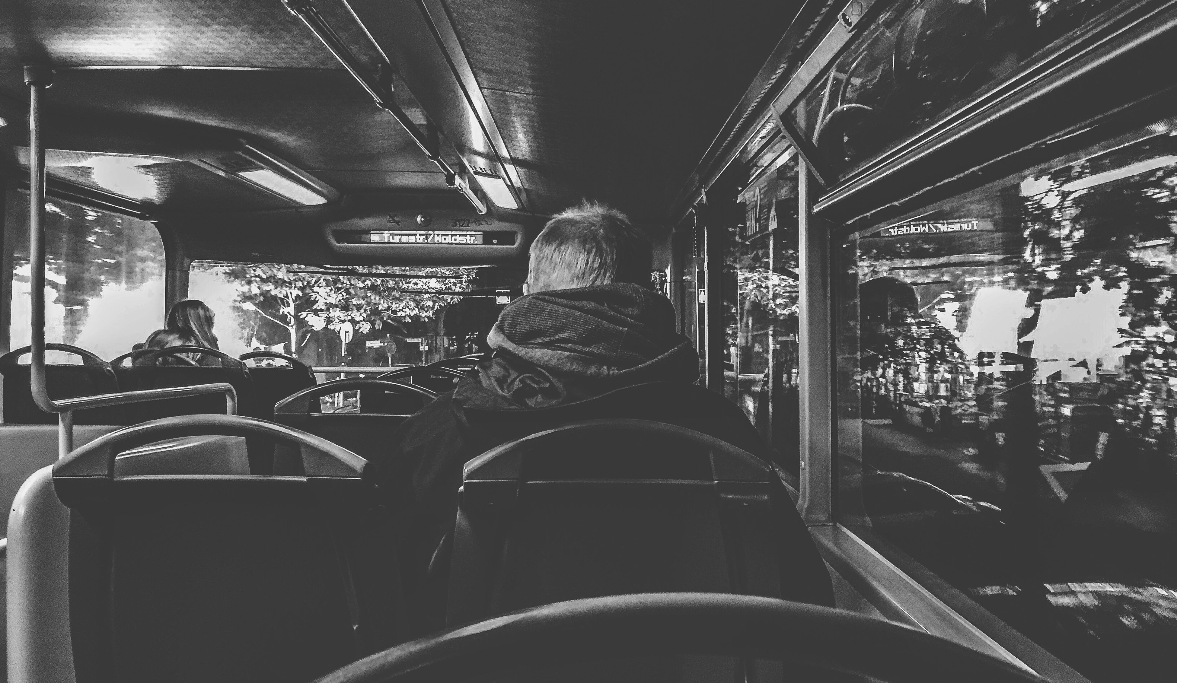 transportation, indoors, public transportation, architecture, built structure, illuminated, mode of transport, retail, land vehicle, store, bus, train - vehicle, incidental people, travel, rail transportation, vehicle interior, text, night, vehicle seat, city
