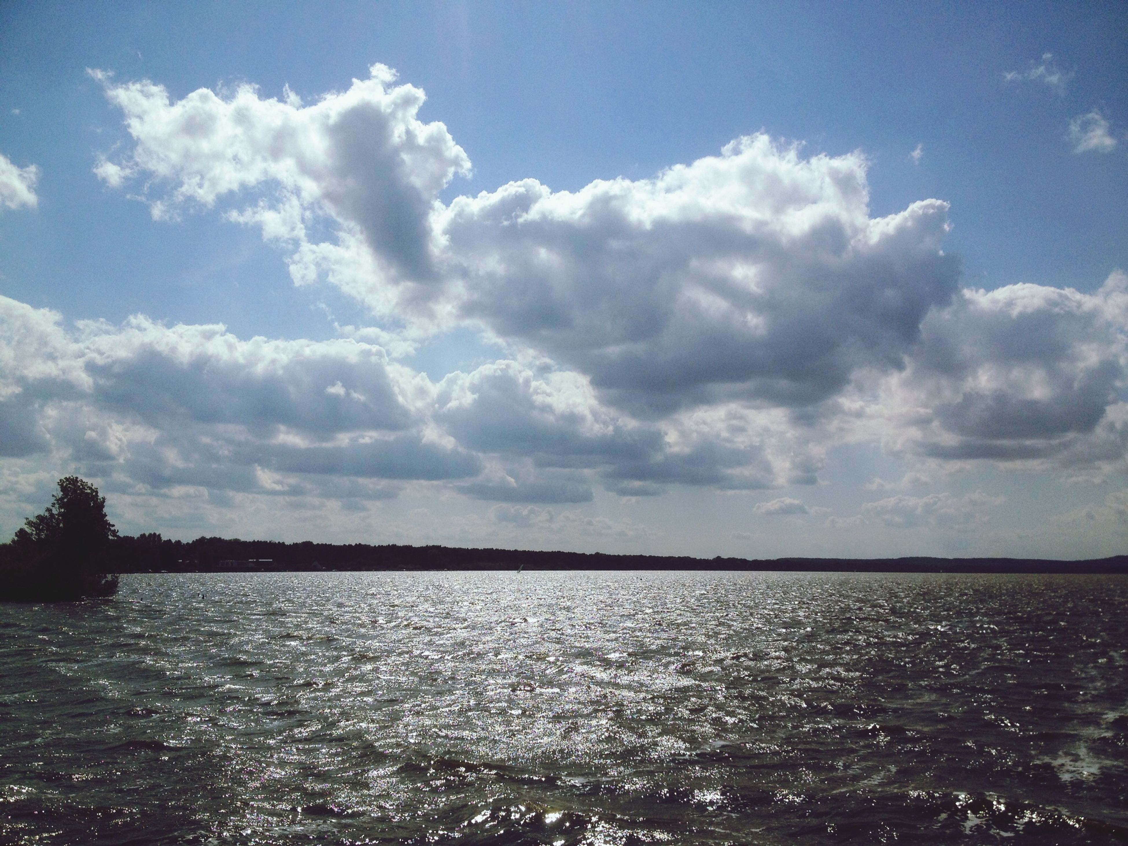 water, sky, tranquil scene, waterfront, tranquility, scenics, cloud - sky, beauty in nature, sea, rippled, nature, cloud, cloudy, idyllic, lake, outdoors, river, reflection, no people, sunlight